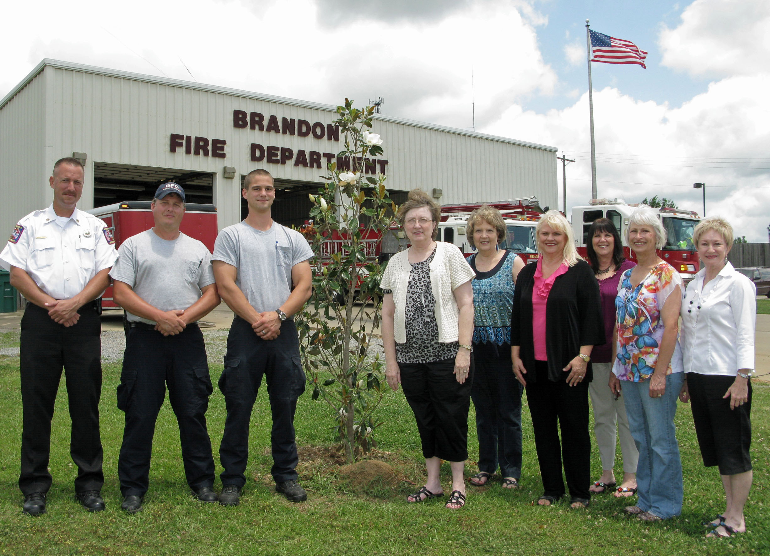BRANDON GARDEN CLUB DONATESMEMORIALTREEFOR ARBOR DAY  Brandon Garden Club (BGC), The Garden Clubs of Mississippi, Inc., planted a Little Gem Magnoliatreeat Brandon Fire Station #1 on Marquette Road for Arbor Day. Arbor Day is a nationally-celebrated observance that encouragestreeplanting and care. Thetreewas planted in honor/memory of two Brandon firefighters, Ochel Davidson and Trent Mangum, both of whom lost their battles with cancer. They were both former students of Brenda Emmons, the Arbor Day Project Chairman (not pictured). Pictured (l to r): Assistant Fire Chief Richard Fortune, Lt. Shane Jennings, Firefighter Don Fortin, BGC President Dixie Vance, Suzanne Ross, Deena Moore, Delena Hamel, May Hall, and Charla Jordan.