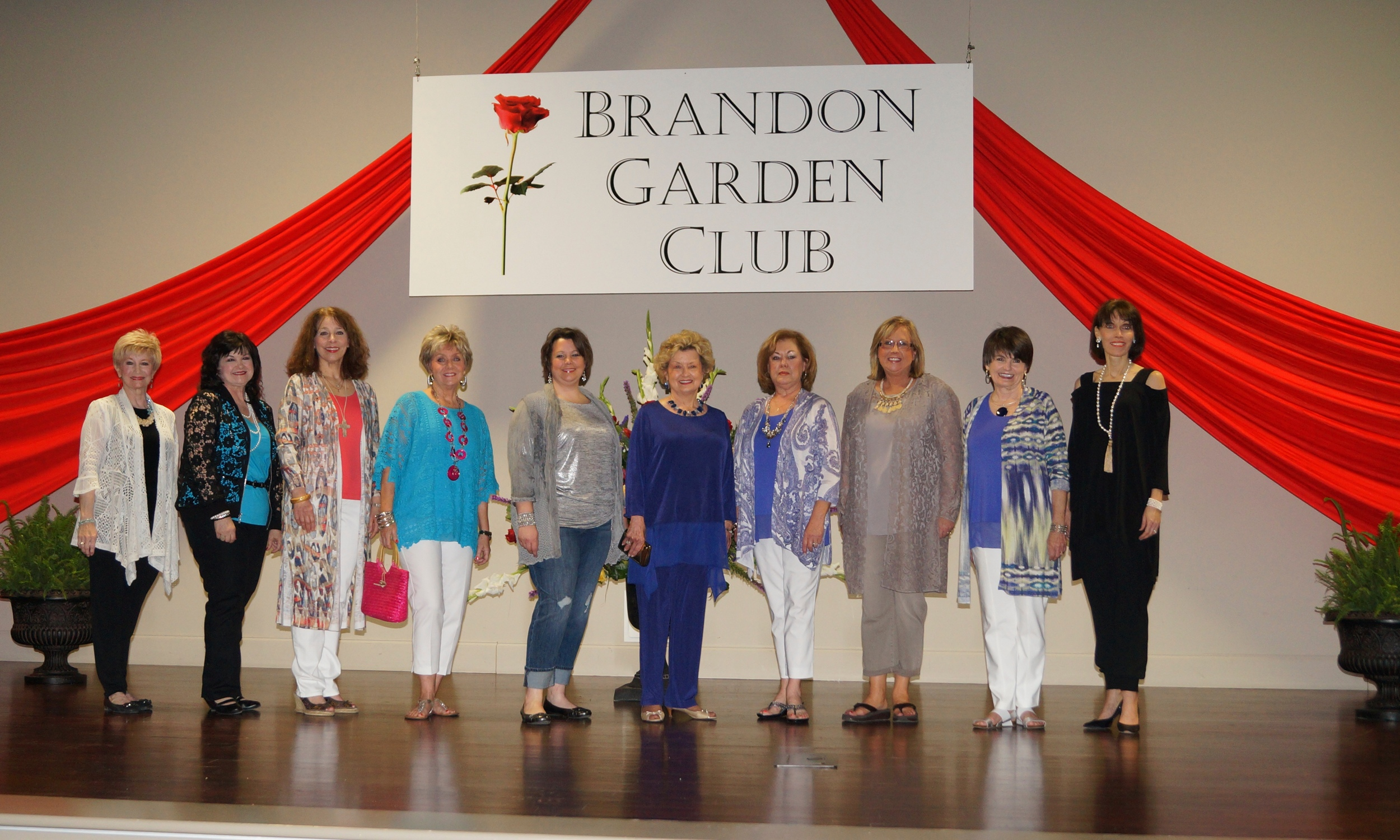 Brandon Garden Club's (BGC) eighth annual  Tablescapes  Luncheon included a fashion show with clothing from Chico's Flowood. Former BGC Presidents and BGC's 2013 Hinds Community College Scholarship recipient were models. Pictured (l to r): Charla Jordan, BGC President; Brenda Sumrall Smith, Fashion Show Chairman; Camille Ferris; Cathy Brown, Ashley Vaughan; Marianna Martin; Linda Hogue; Marilyn Hughes; Terry Guest; and Trudy McLaurin.