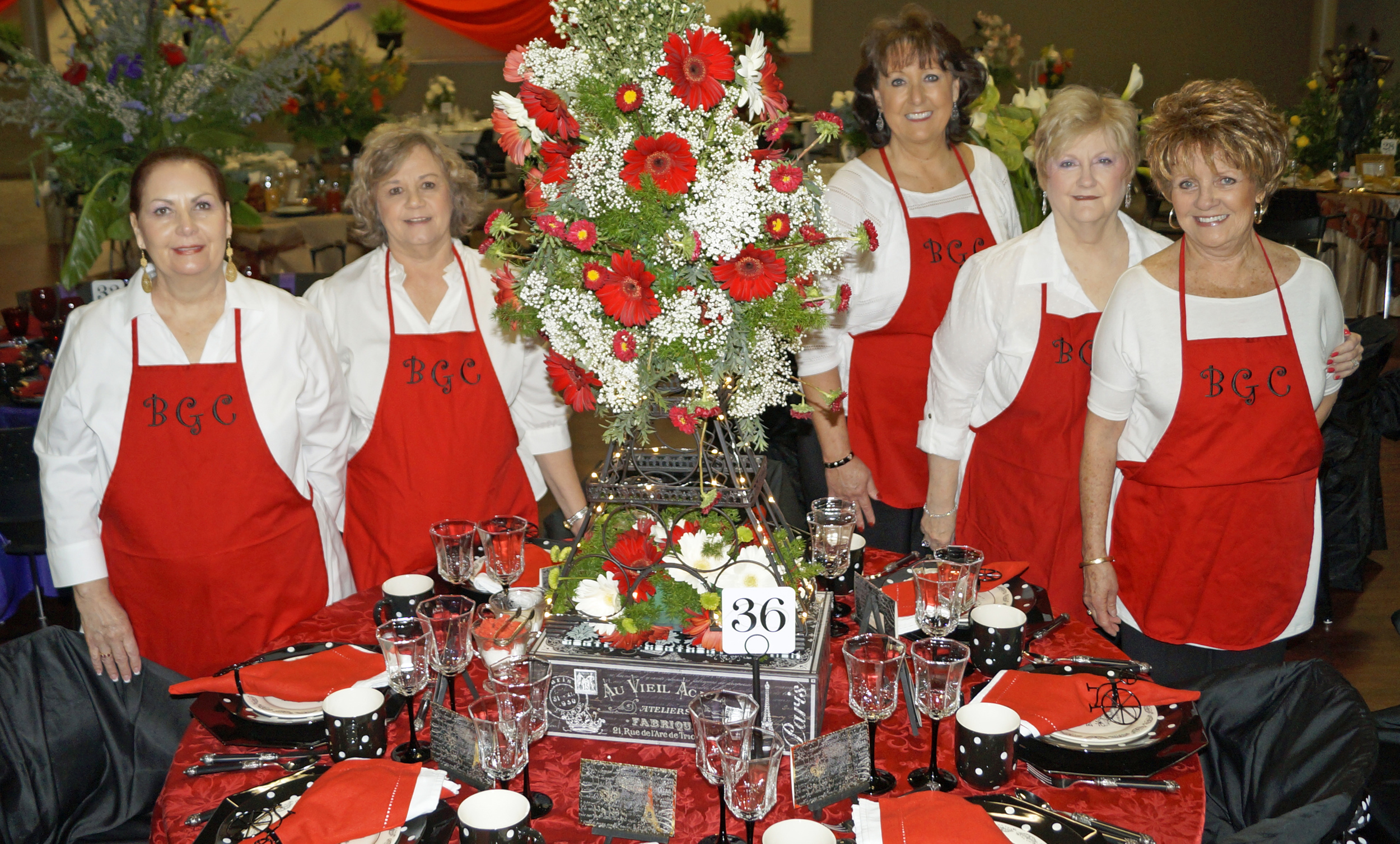 """Brandon Garden Club's eighth annual  Tablescapes  Luncheon fundraiser included 40 uniquely decorated  tables  , celebrity servers, and a fashion show featuring former BGC presidents as models. Pictured (l to r) at the """"Paris Flea Market""""  table  are club members Kathy Fletcher, Martha Powell, Marie Lodes, Sharon Hoffman, and Marion McKee."""