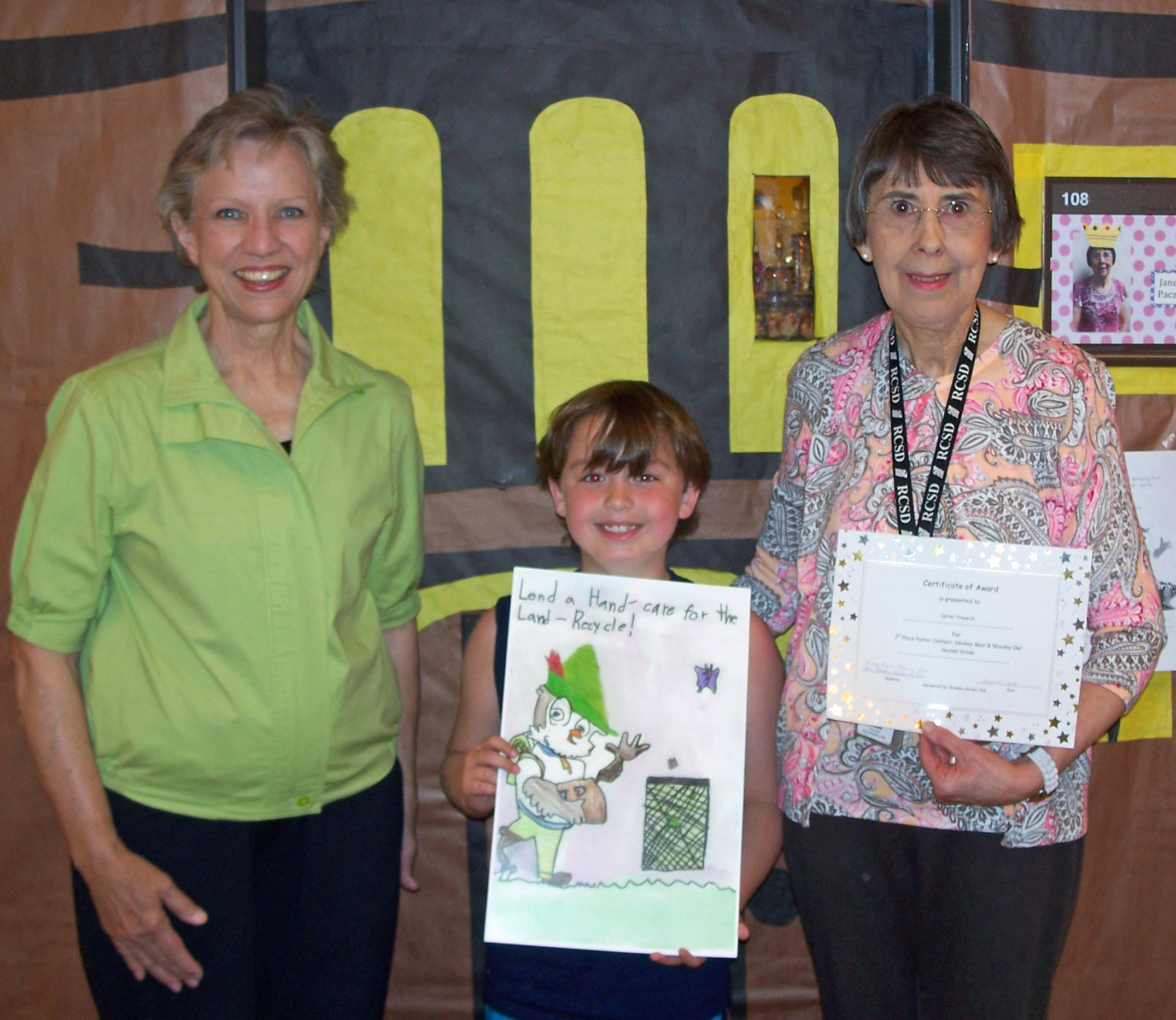 Carter Traywick, second grade Venture student at Stonebridge Elementary School, was the First Place winner at the local and state levels of theSmokeyBearand Woodsy Owl poster contest sponsored by the Brandon Garden Club (BGC), The Garden Clubs of Mississippi, Inc., to increase students' awareness of fire prevention and basic environmental conservation principles.SmokeyBearteaches children and adults to be careful with campfires, barbecues, trash fires, and matches. Woodsy Owl encourages children to join him by taking an active role in caring for the land through recycling, reusing, and reducing waste; planting and caring for trees; using resources wisely (such as not wasting water or electricity); not littering; and generally caring for the planet.  Pictured (l to r): BGC Chairman Joan Alliston, Carter Traywick, and Venture teacher Janet Paczak.