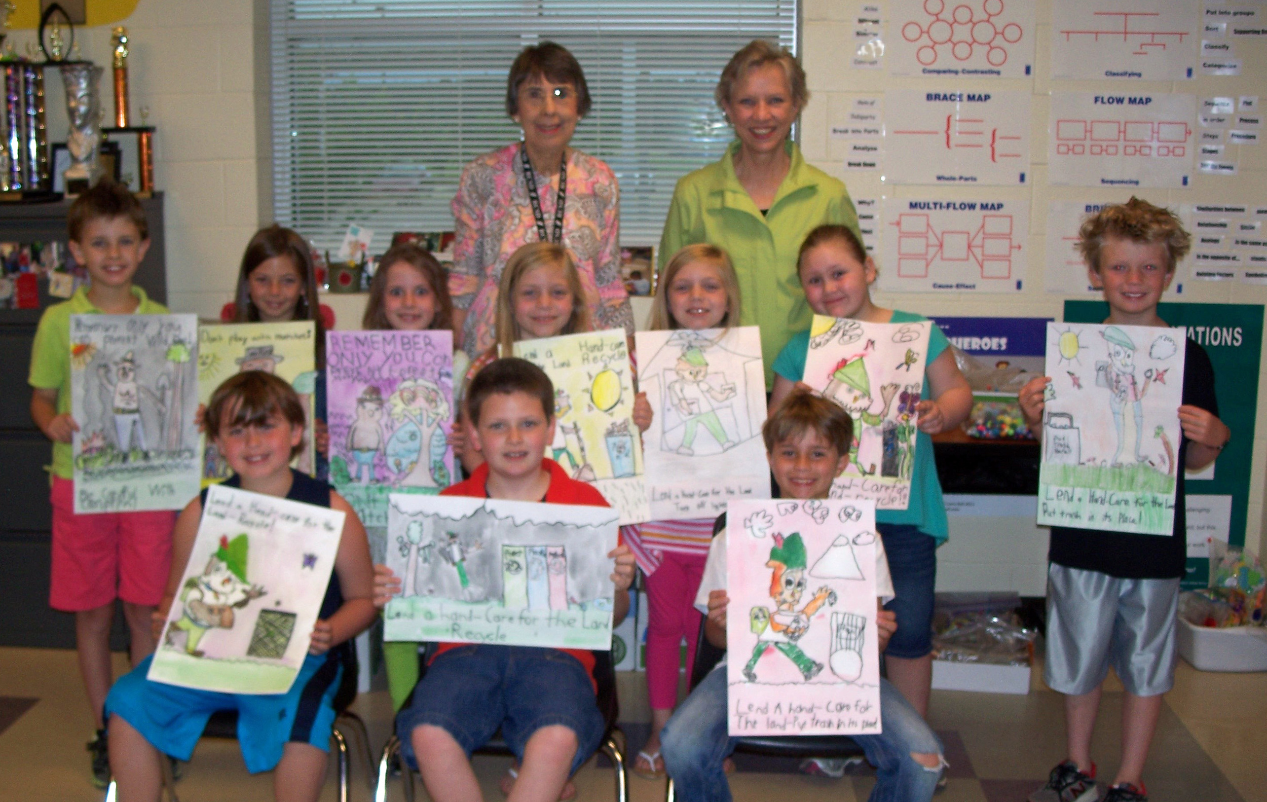 First row (l to r): Carter Traywick, 1 st place; Bennett Ciaravine, 2nd place; and Connor Cone, 3rd place. Second row (l to r), honorable mention: Hayden Smith, Valerie Harrell, Leslie Reeves, Carsen Flowers, Camden Flowers, Saydra Snider, and Cole Gordon. Third row (l to r): Venture teacher Janet Paczak and BGC Chairman Joan Alliston.