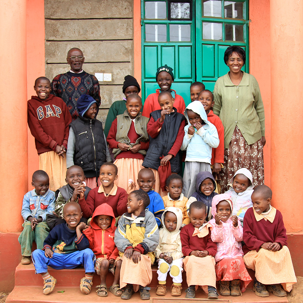 BOC founder Pastor Mary (top right), seen here with the children who live at the orphanage.