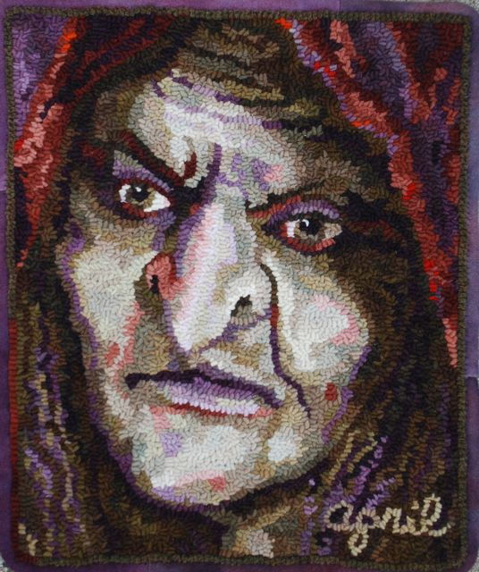 """Matlida the Witch  2011, October,  Faces of the Seasons Series.  13"""" by 16"""". #6-cut on linen. Designed, dyed and hooked by April D. DeConick. Red Jack Palette Wool. 8-Value Packs of Fincastle Brown 141; Lady Willow 128; Fingorn Forest 149; Spanish Moss 140; Black Orchid 146; Highland Lilac 133; Red Oak 144."""