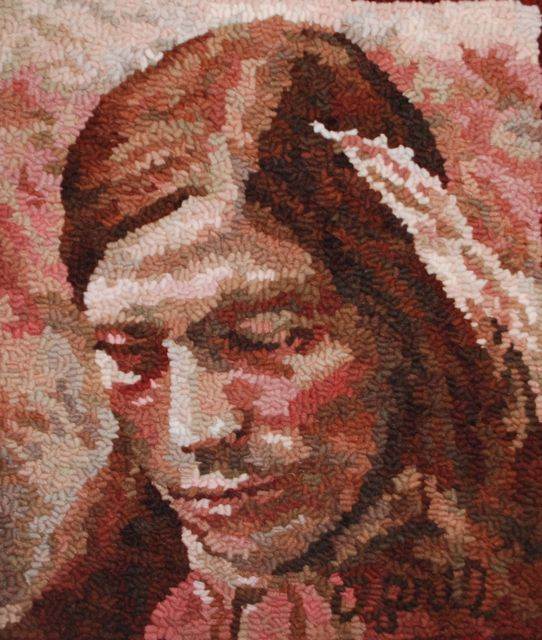 """Squanto  2011, November,  Faces of the Seasons Series.  12"""" by 13"""". #6-cut on linen. Designed, dyed, and hooked by April DeConick. Red Jack Palette Wools. 8-value packs of Wilde Wood 117; Faune Brown 114; Hubbard Fig 119; Sea Shells 142; Red Oak 144; Toadstool 121."""