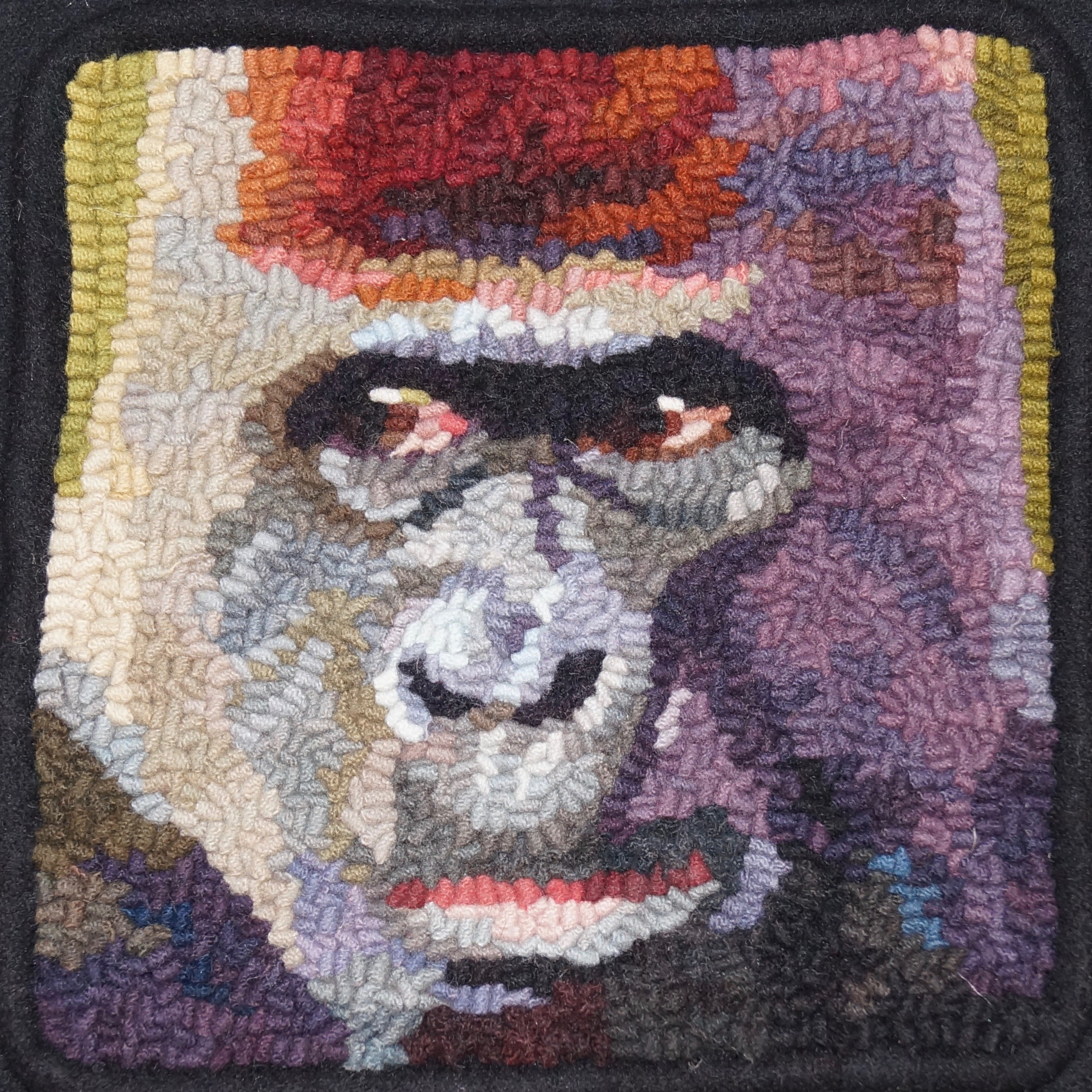 Gorilla 2019. 6-cut wool on linen. Designed, Dyed, and Hooked by April D. Deconick.