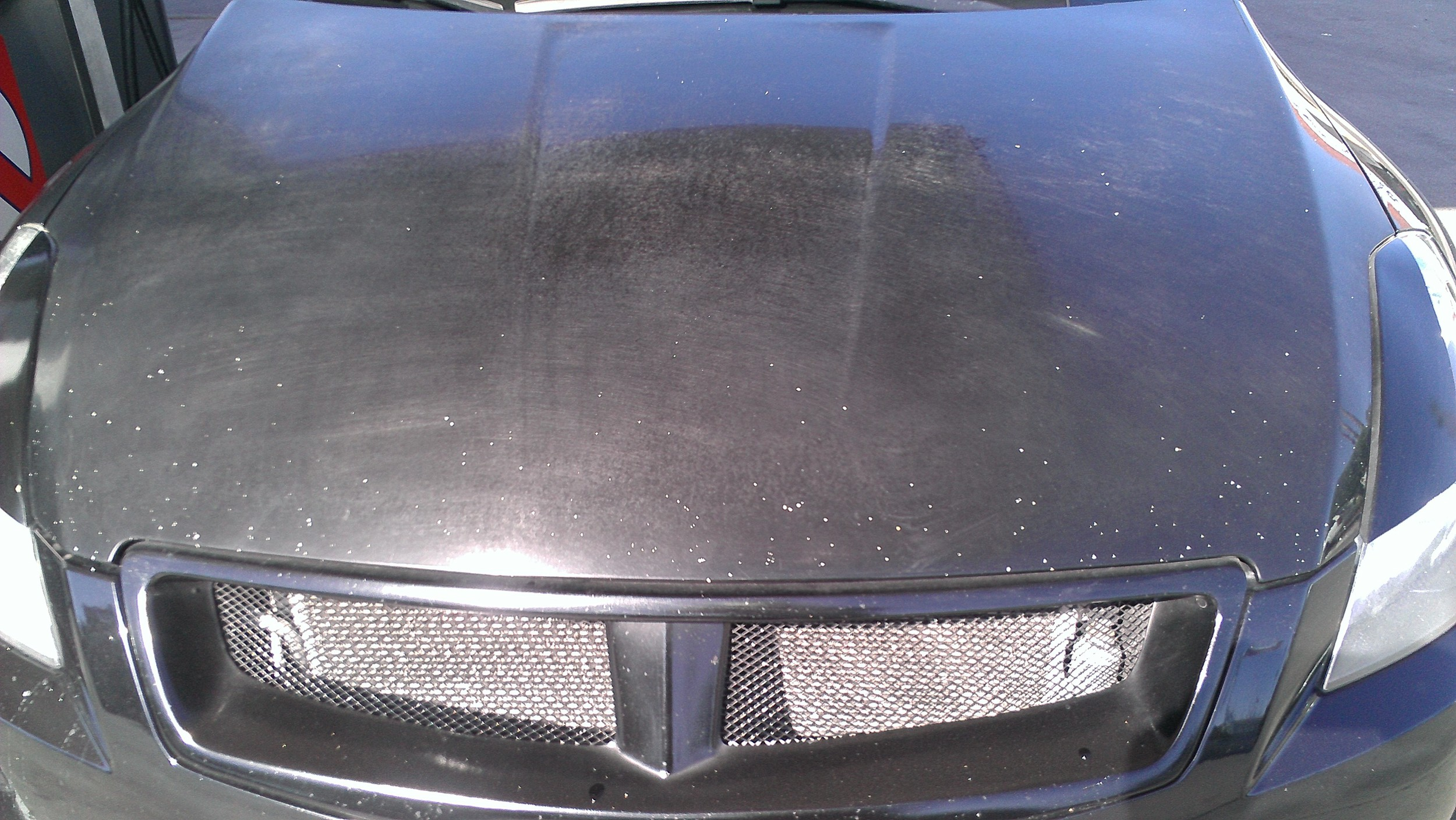 Clearcoat failure almost to the point of no return caused by improper washing techniques, lack of UV protection (lack of paint sealants/wax) and prolonged extreme exposure to the sun and heat.