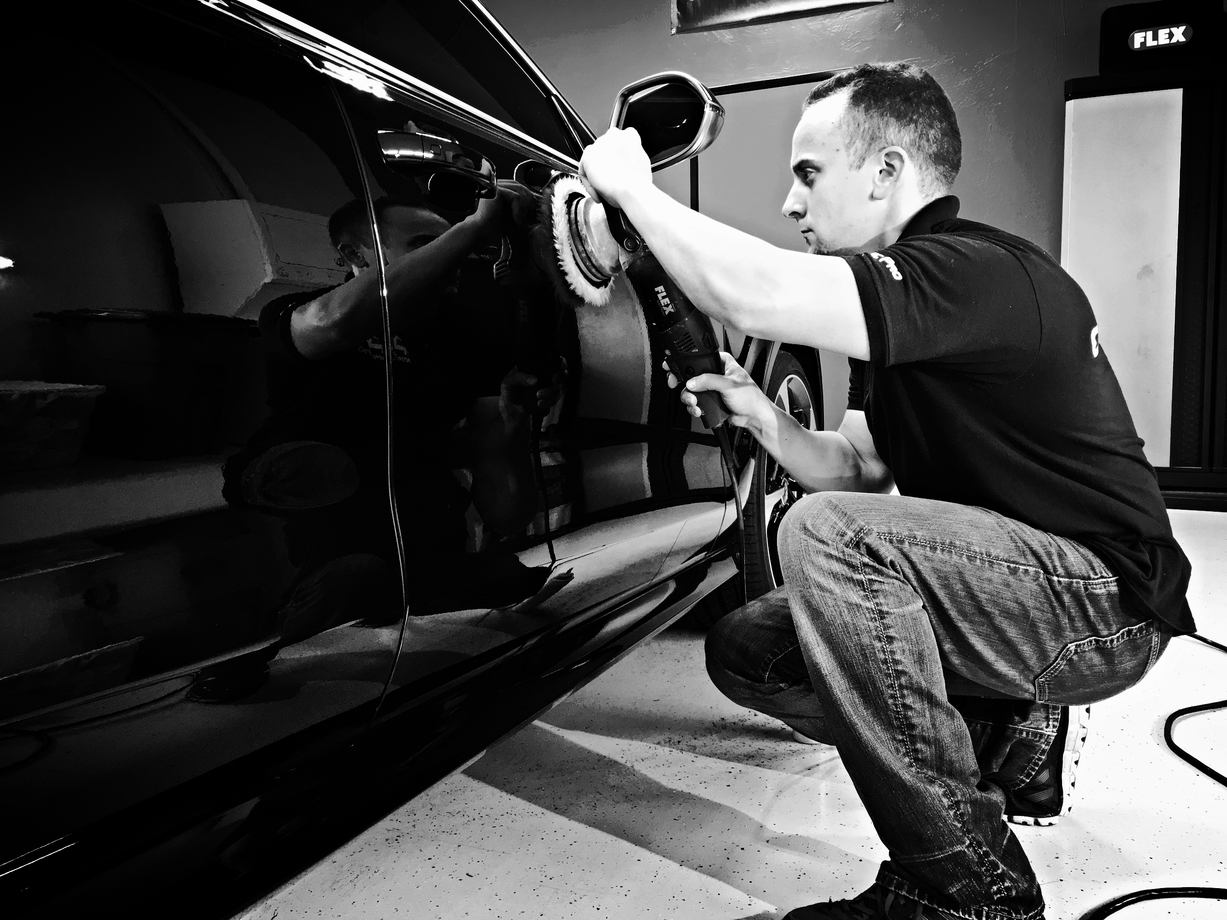 Co-owner Chris Parker performing the first stage of paint correction in the Deluxe Stage 2 Paint Correction Process