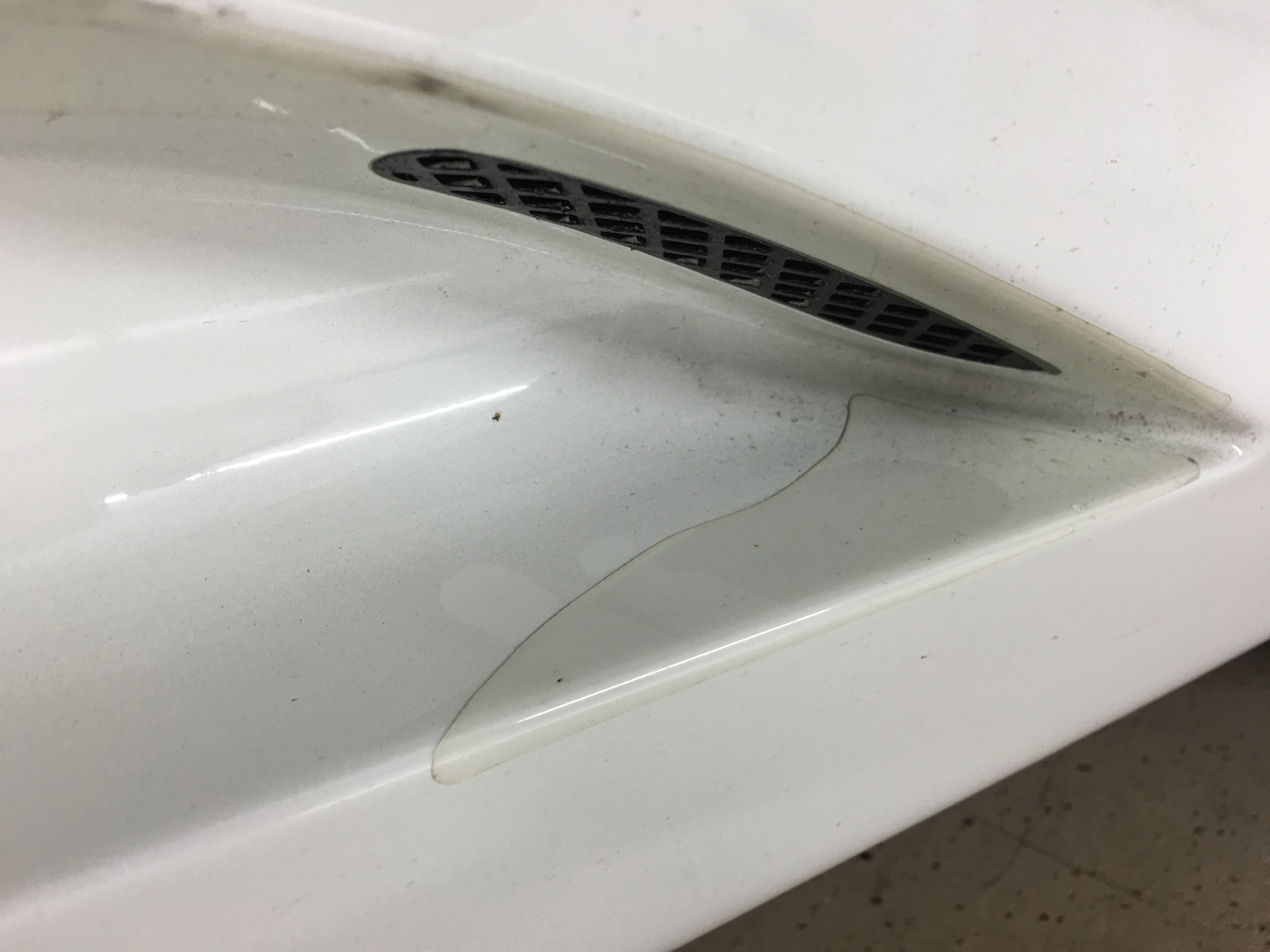 Aged paint protection film on lower rocker panel