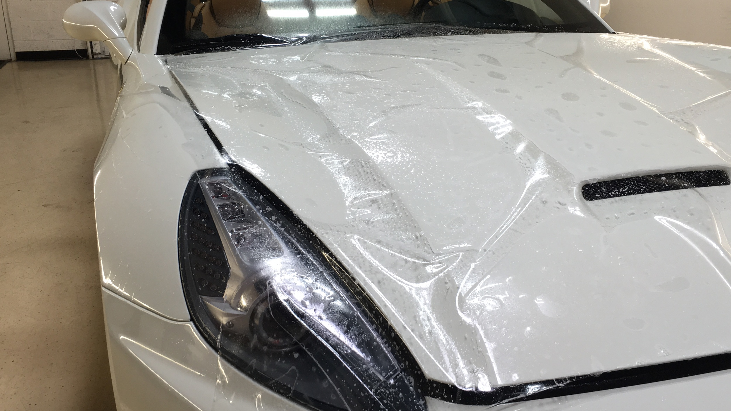 XPEL laid over hood prior to installation process