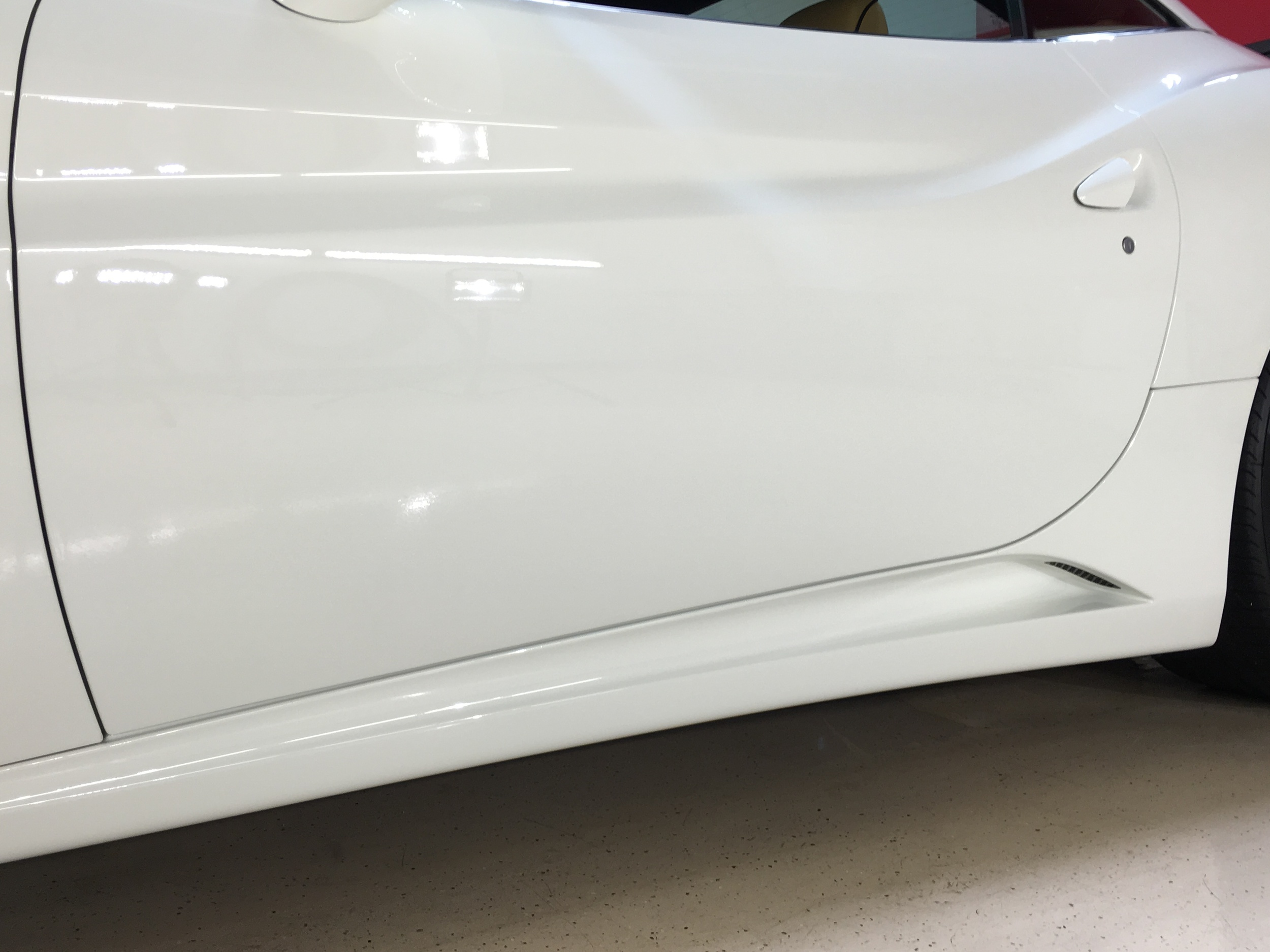 High-Gloss finish achieved through proper paint correction procedures and Ceramic Pro. White never shined so bright!