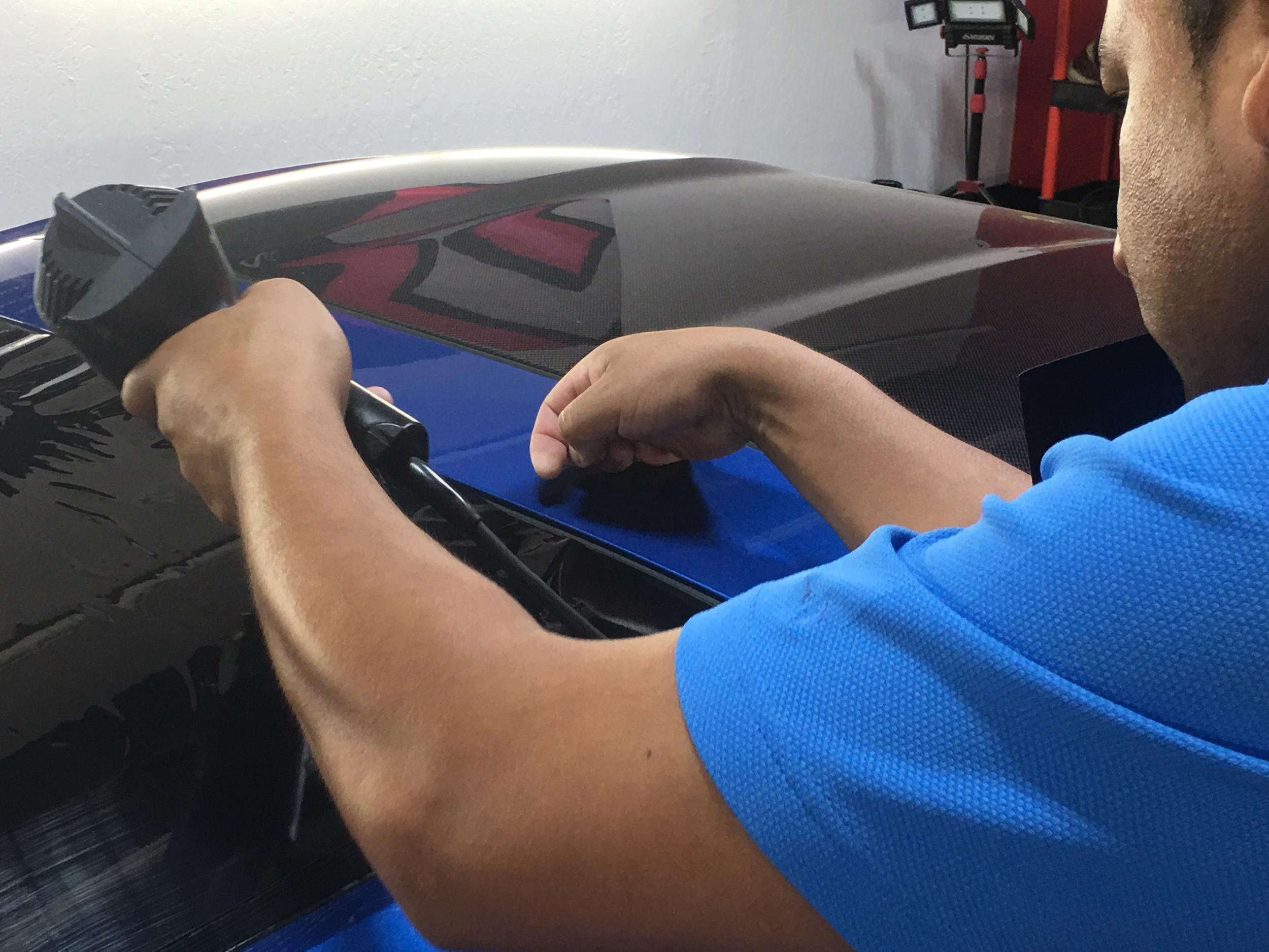 Rear window film shrinking process prior to installation
