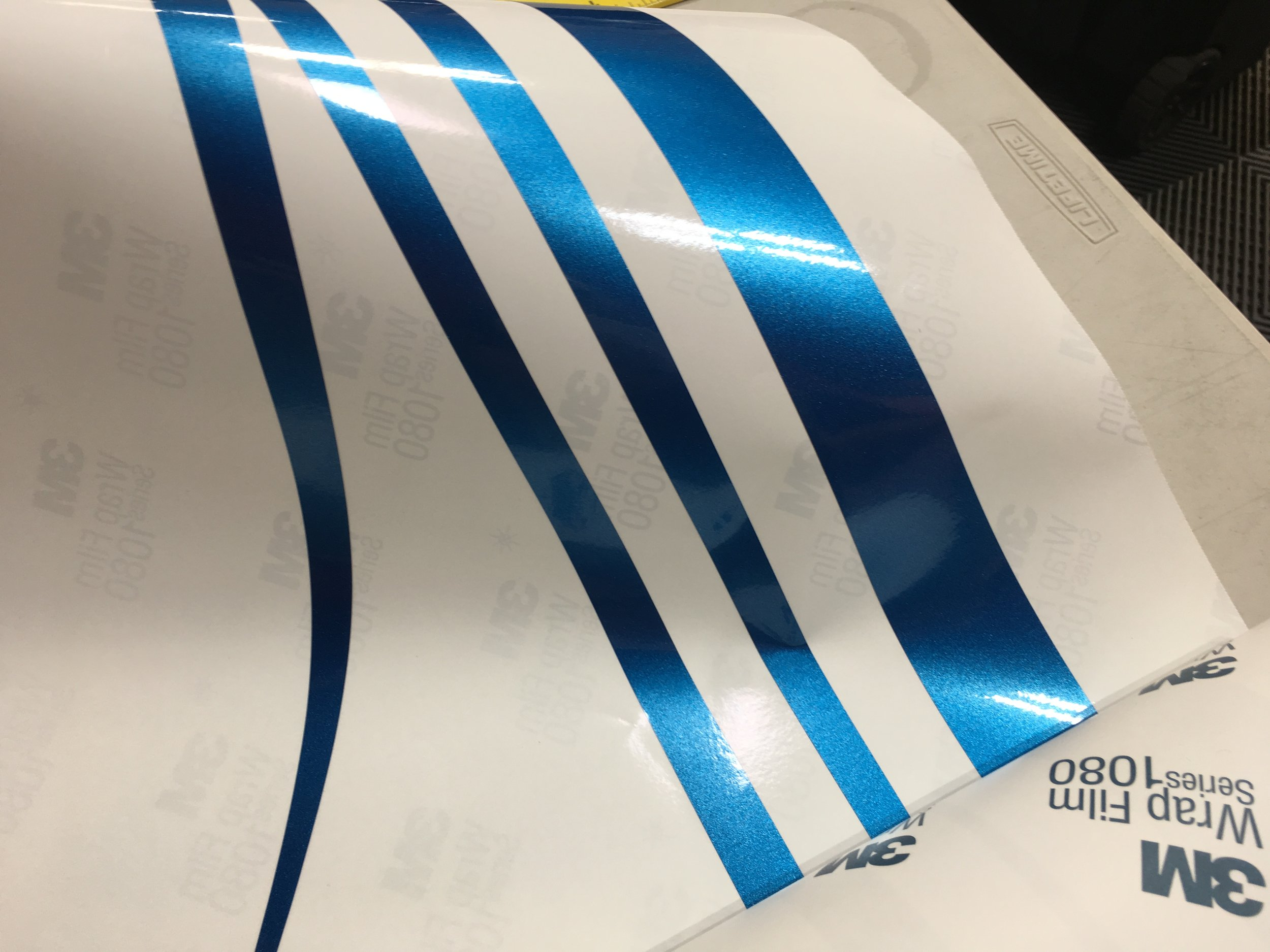 New vinyl stripes printed to lay over the pearl white vinyl