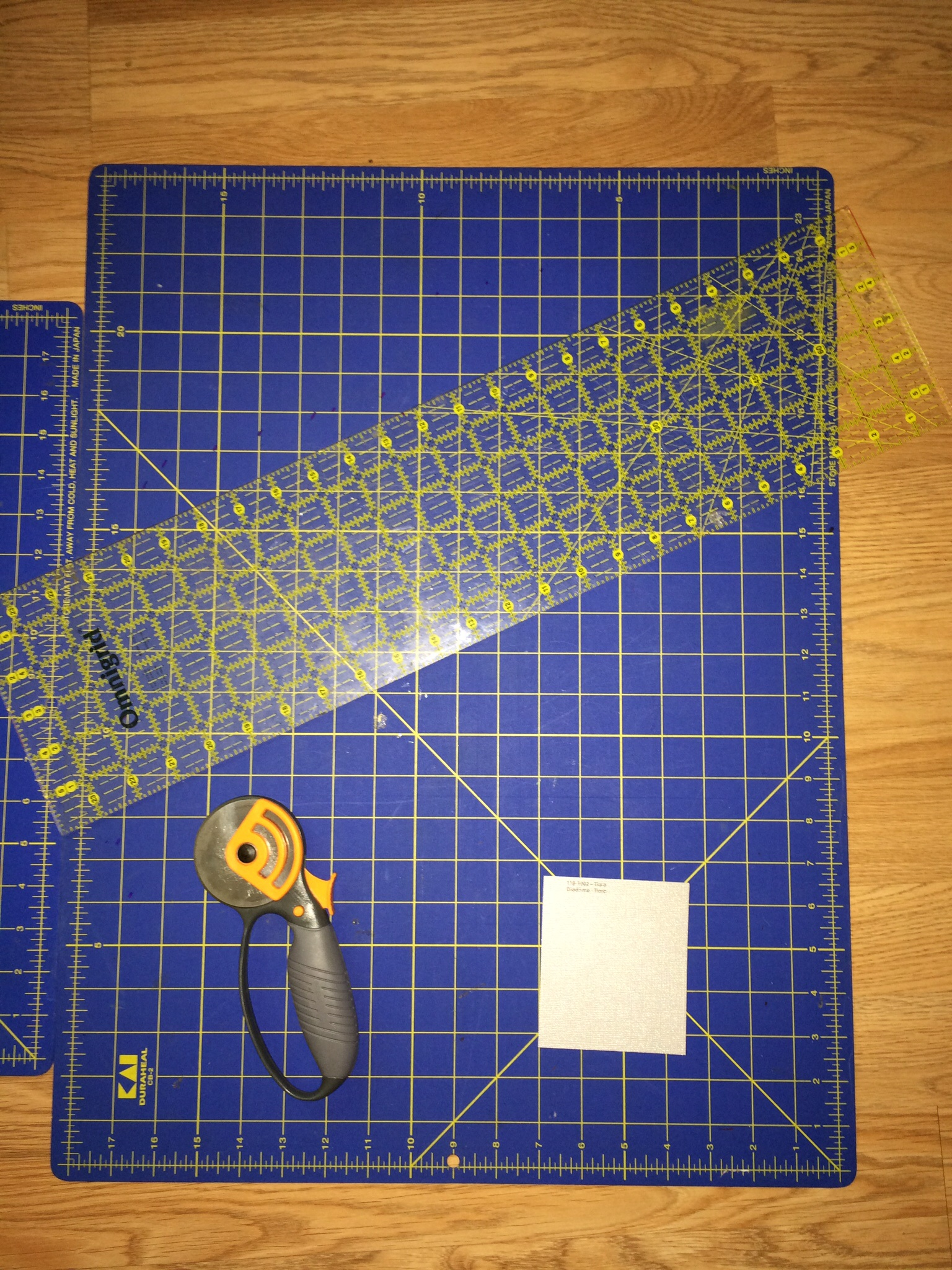 Tools used for the project, a rotary cutter, straight edge and a good cutting surface.