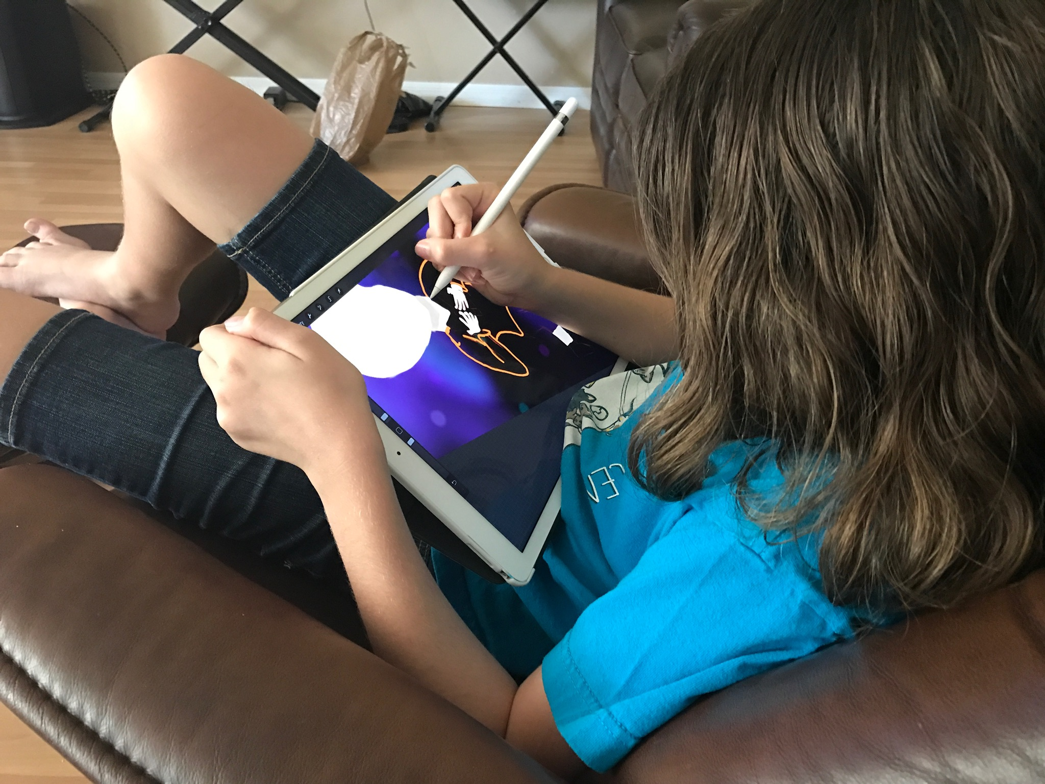 My daughter creating artwork for a comic book she is writing for school