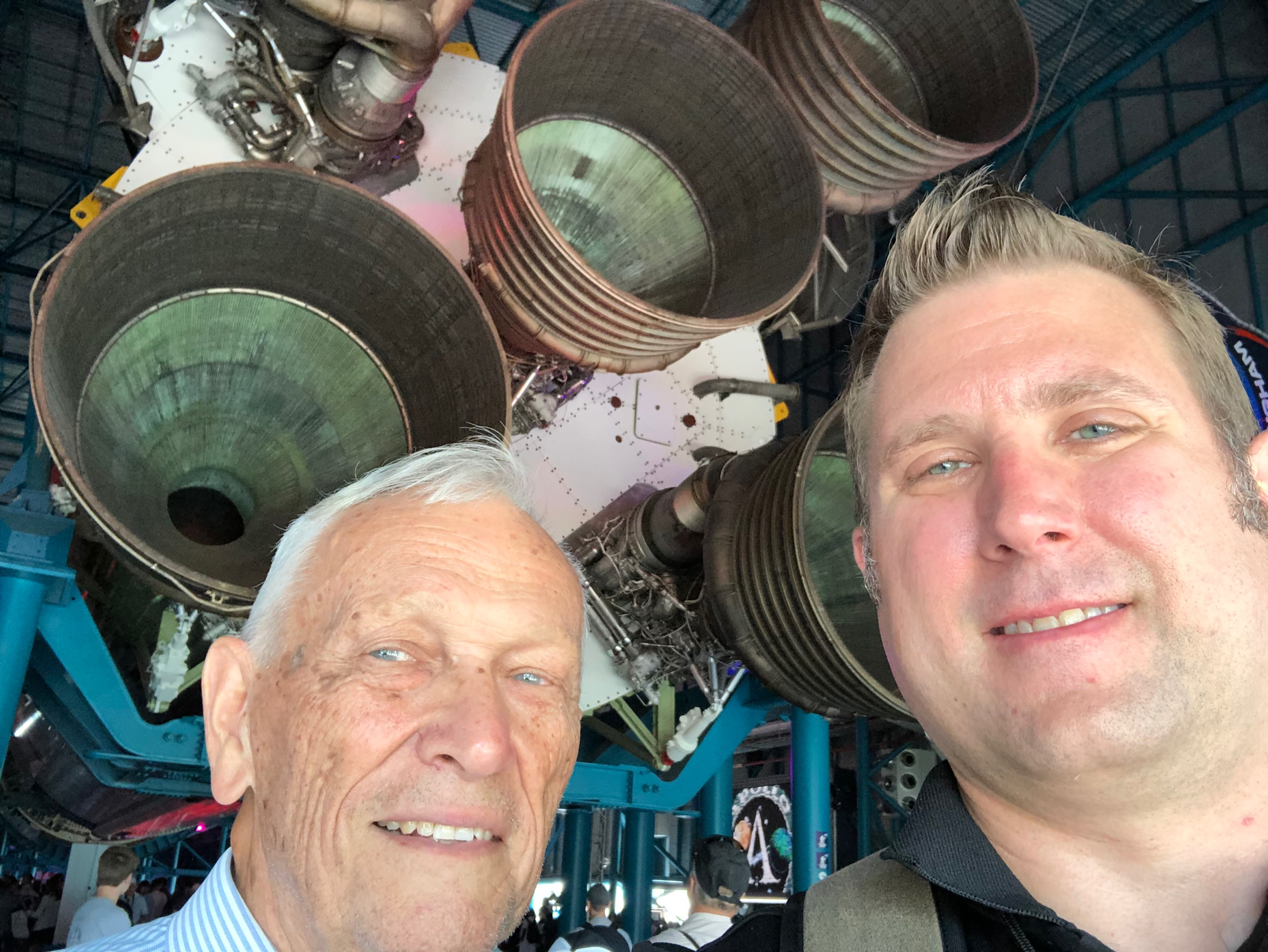 Doctor Wyck Hoffler and I in front of the Saturn V rocket during the 50th anniversary stamp ceremony