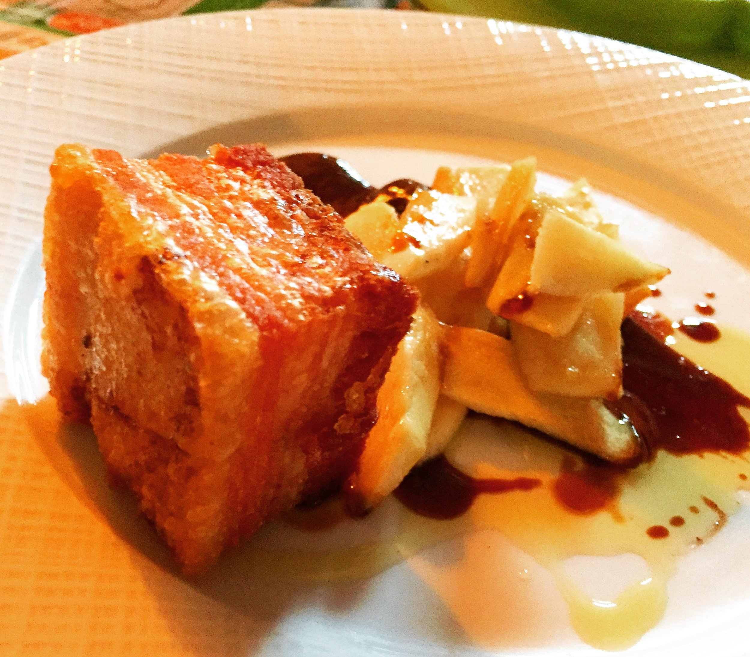 Pork belly with braised cabbage and apple salad