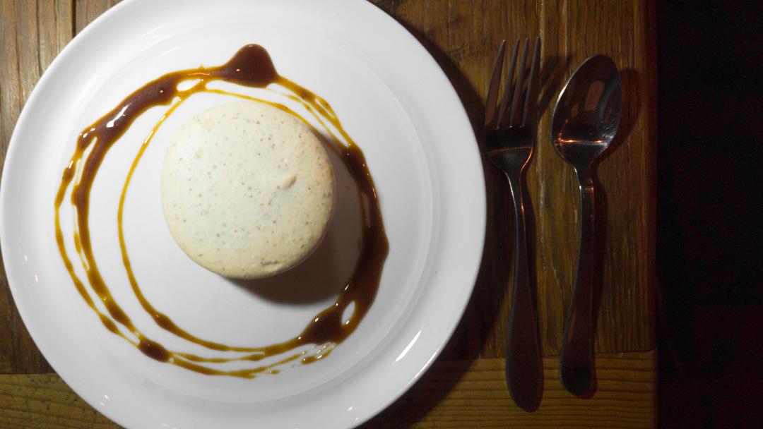 almond macaron, persimmon cream, nocino caramel