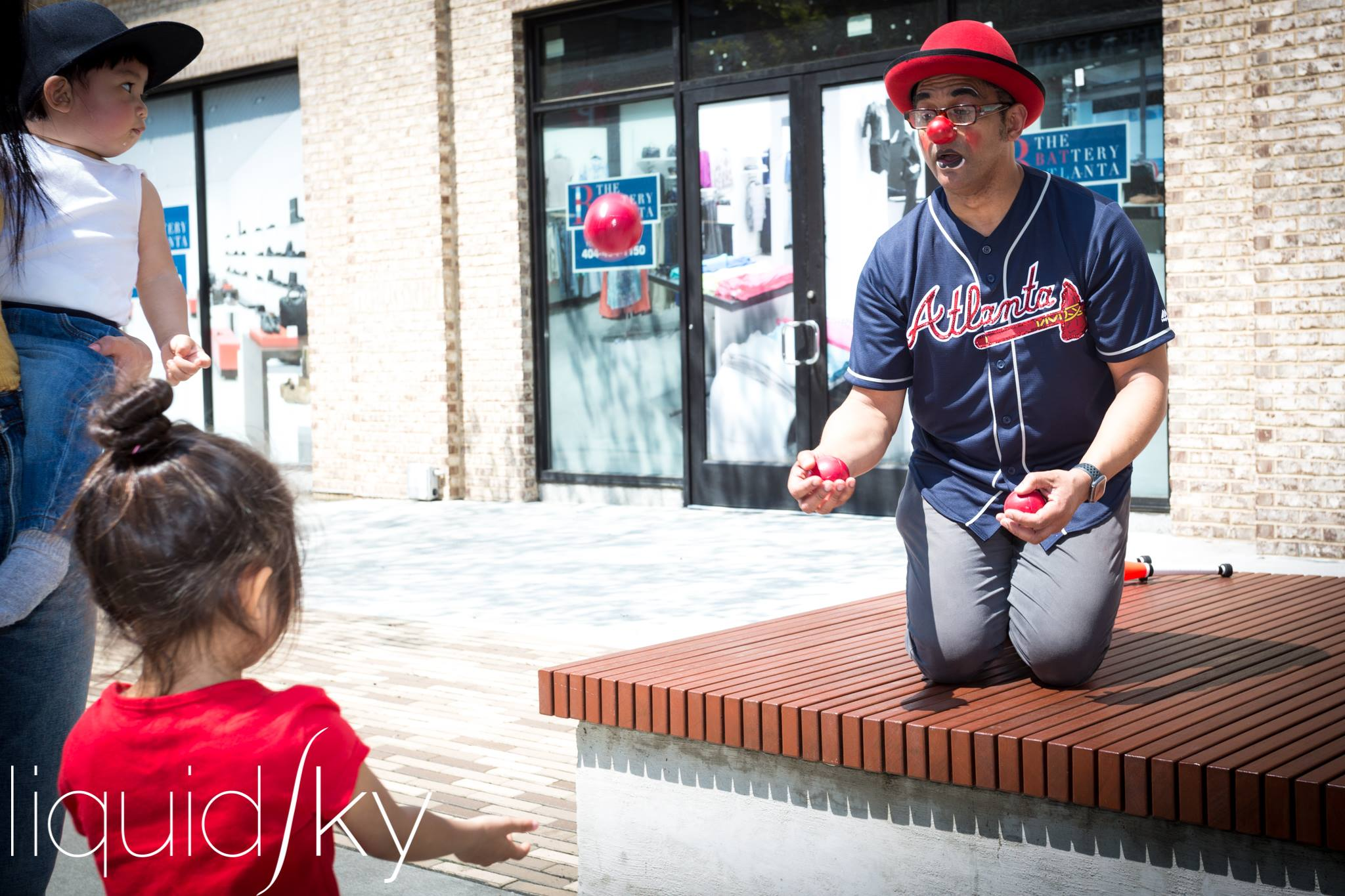 Liquid Sky at Braves toss with child.jpg