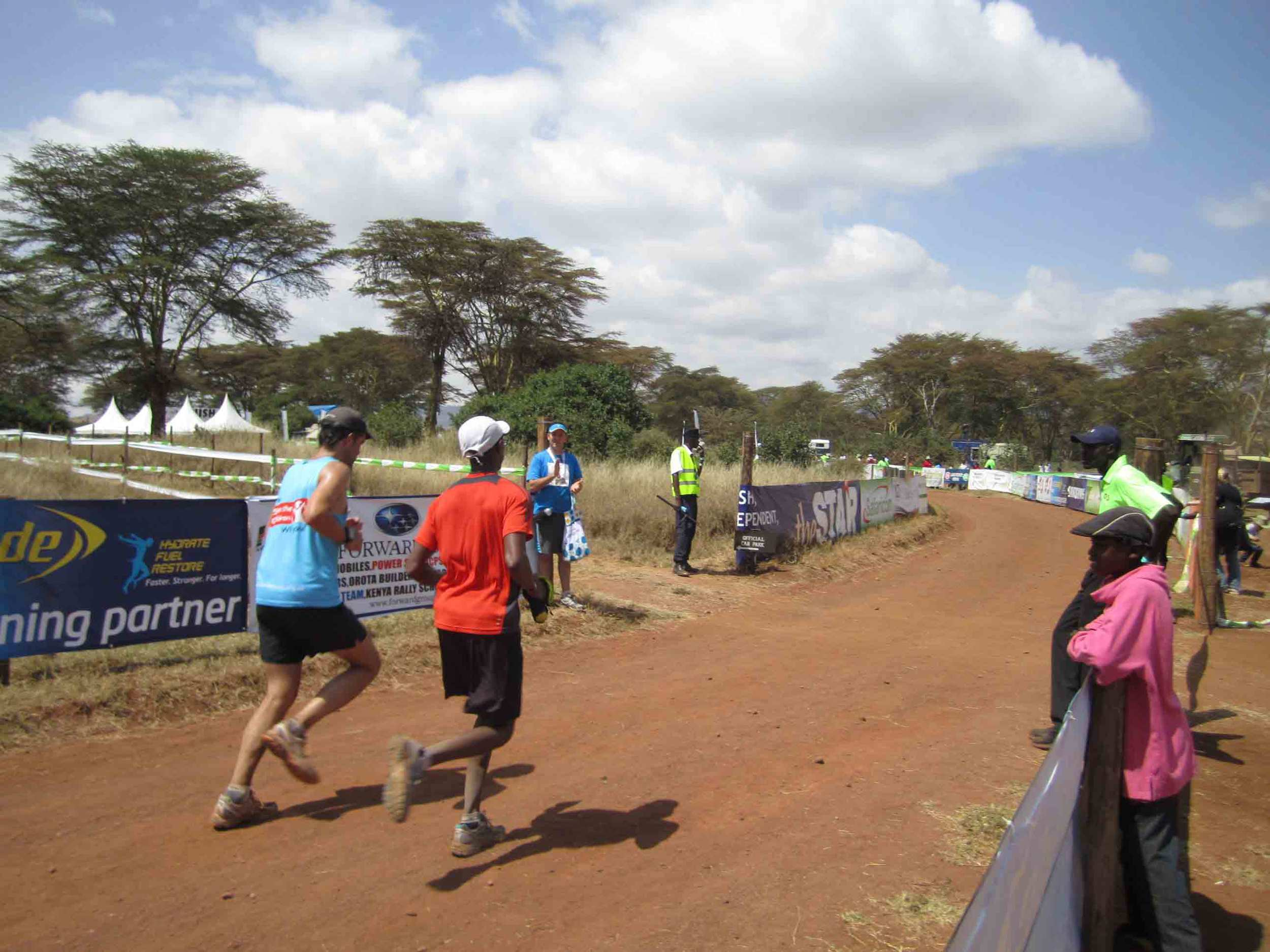 A four-hour trip north of Nairobi brings you to the site of your Half-Marathon or Full-Marathon at the Lewa Game Reserve. Endurance Coach Cory Nyamora (in red) at the 2012 Lewa Marathon