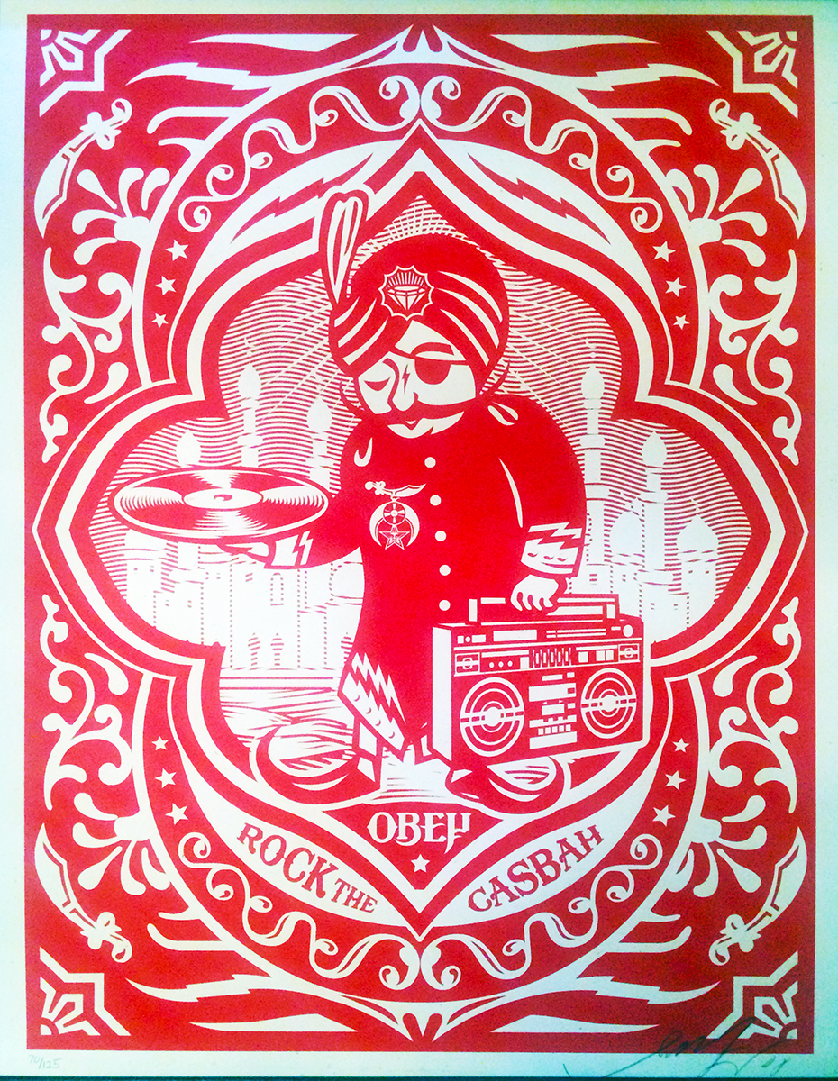 """Rock the Casbah (Red)"" [Edition: 70/125] Screenprint on Paper, Signed by Artist 24"" x 18""  SOLD  During AFHGC, I used to visit Shepard's Gallery and shop fairly frequently. The openings and parties they threw at the Sunset location drew hordes, with long lines to get into the events. Shepard and his family plus staff were very welcoming. This was before the Obama HOPE poster and the 2008 campaign and the mess that followed. I picked up the print at the gallery. The only time it (""Rock the Casbah #70) has been out of the original tube is for the taking of this picture."
