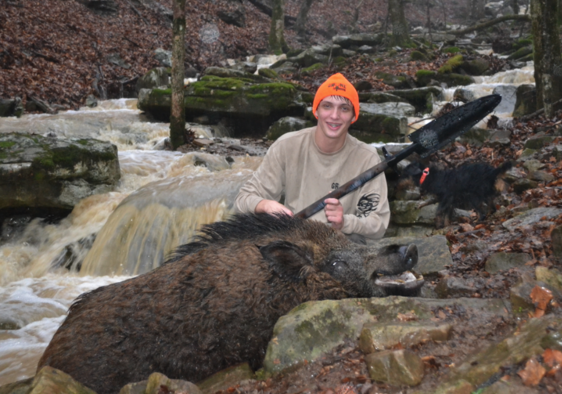 16 YEAR OLD BRAIDEN GREENE WITH MONSTER RUSSIAN BOAR TAKEN WITH A SPEAR. WILDERNESS HUNTING LODGE 2010