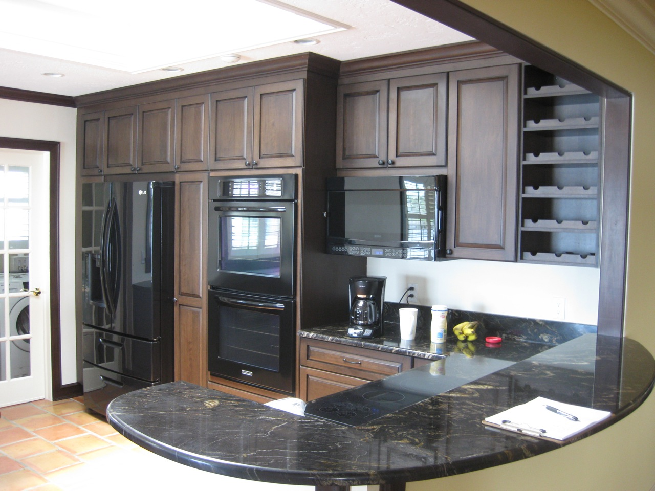 I worked with local craftsmen to create additional trim details which included Red Birch crown moulding and trim finished to match the cabinets and existing trim exactly. This attention to detail provides continuity for the kitchen, blending seamlessly with the existing house.