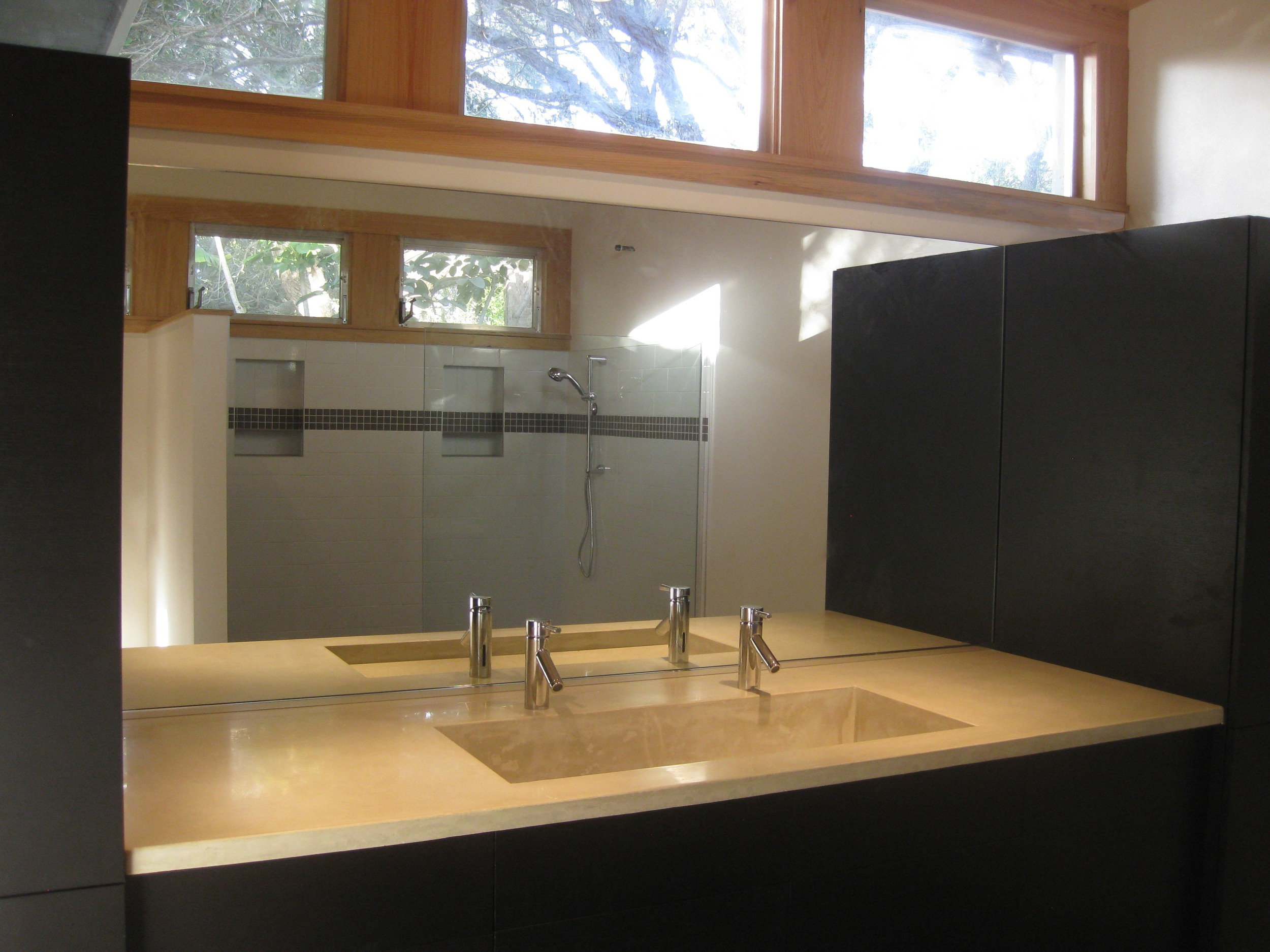 Master Bathroom renovation with custom concrete sink and Cabico cabinetry.