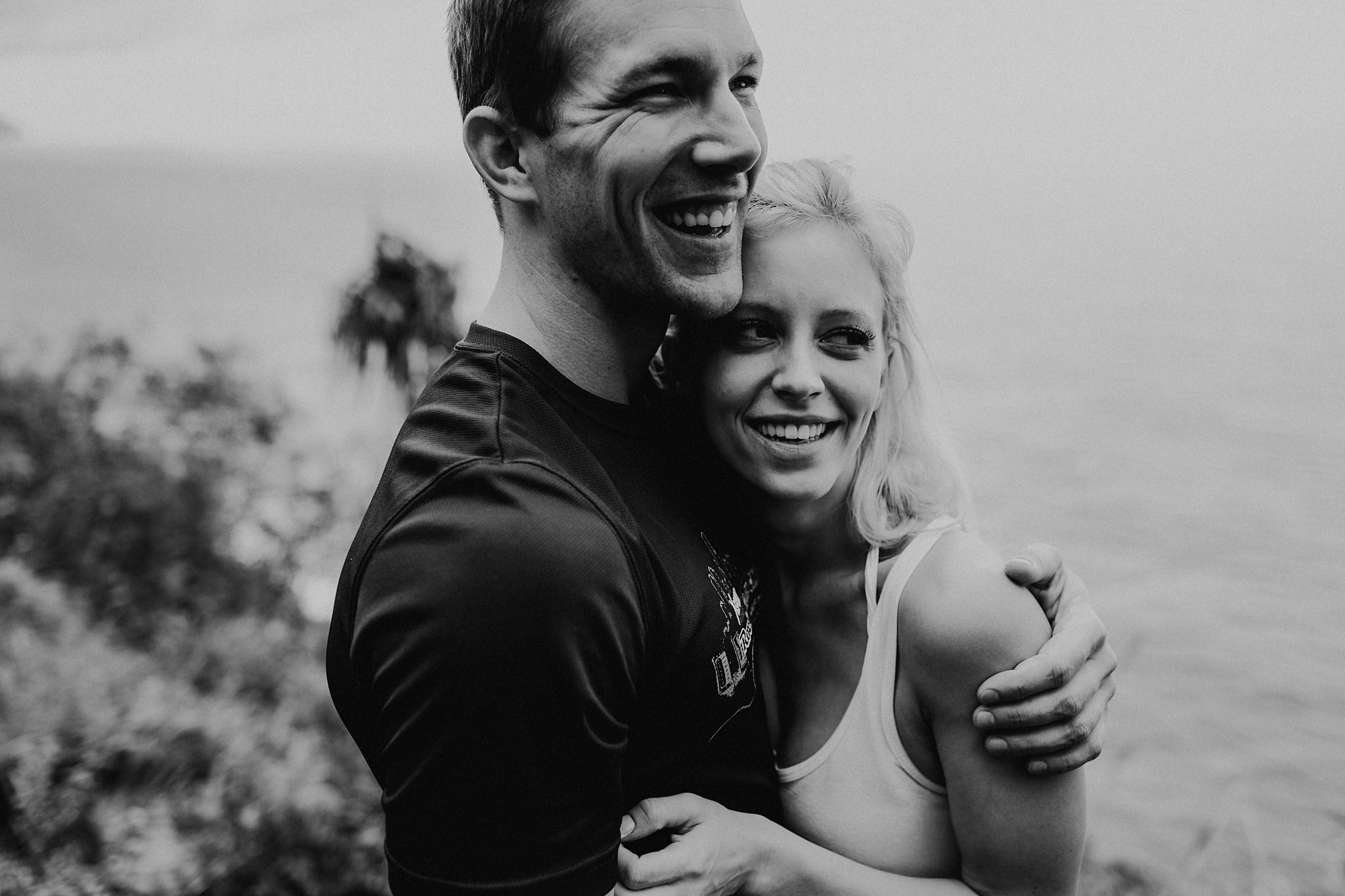 hawaii kauai elopement na pali coast mountain hike bride groom laughing photo
