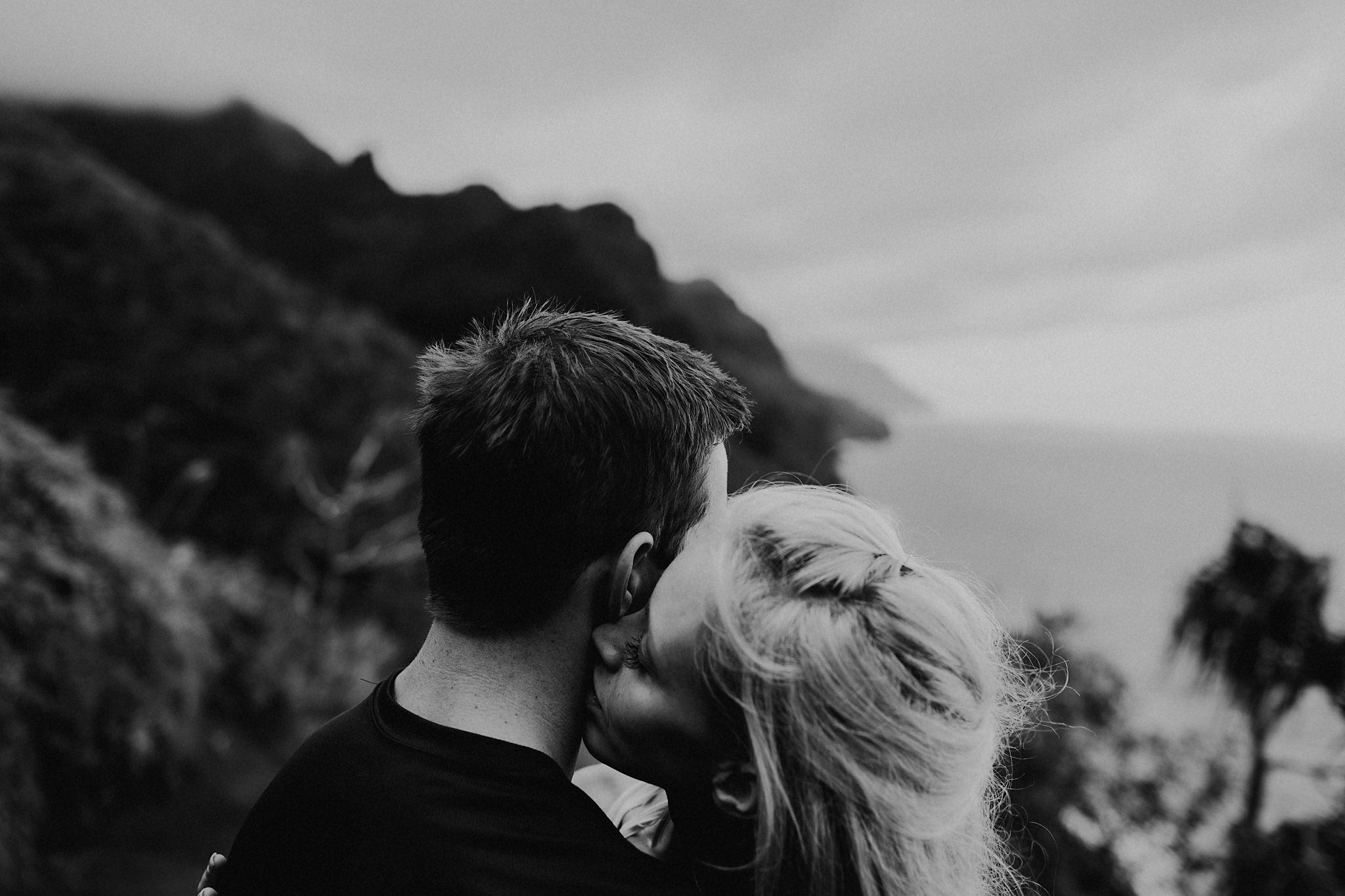 hawaii kauai elopement na pali coast mountain hike bride groom hugging photo