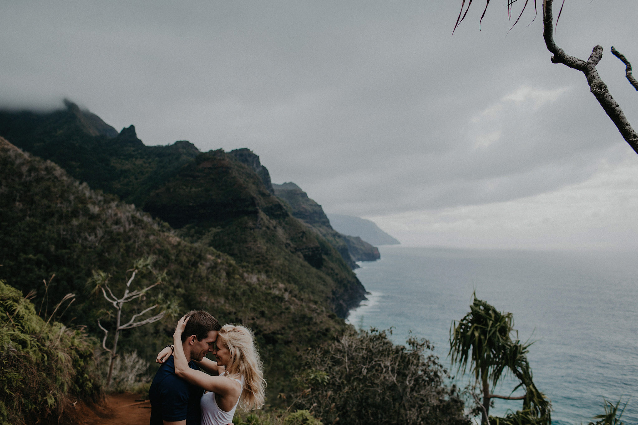 hawaii kauai elopement na pali coast mountain hike bride groom hugging photo