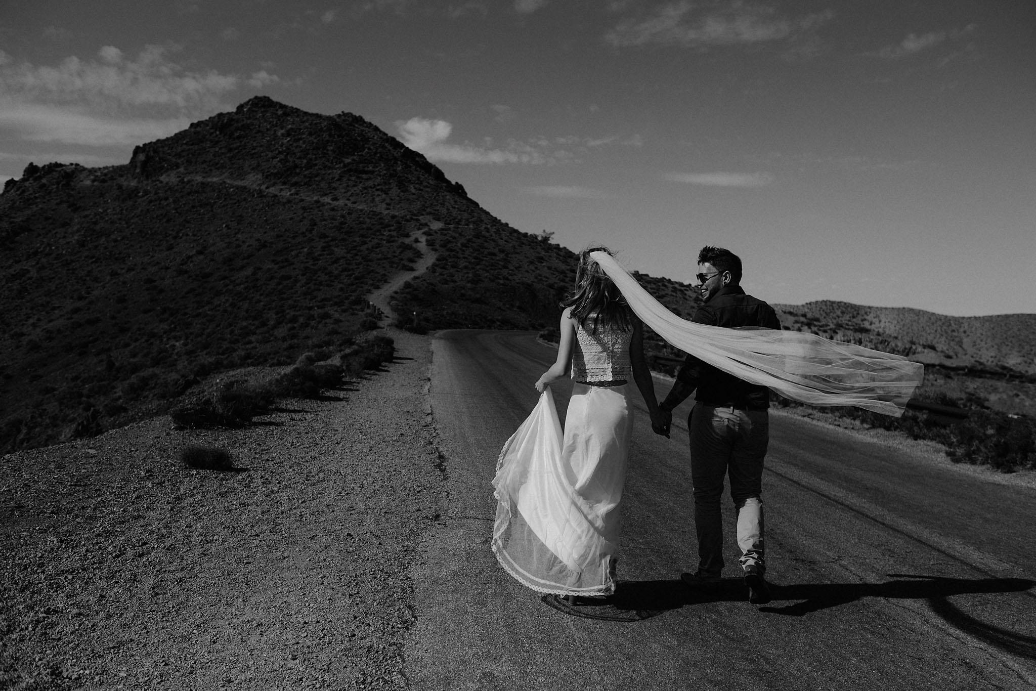 death valley adventure elopement wedding photographer national park couple walking portrait
