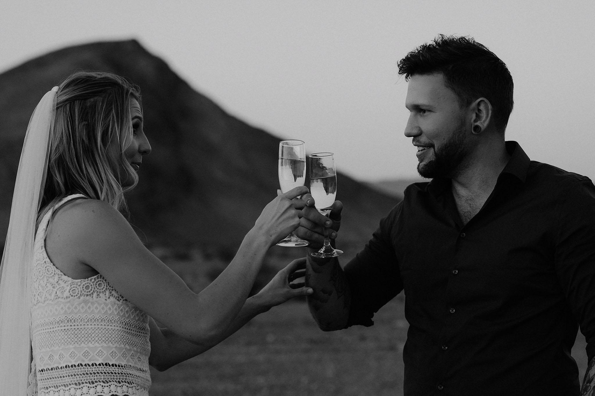 death valley adventure elopement wedding photographer national park couple sunset portrait champagne