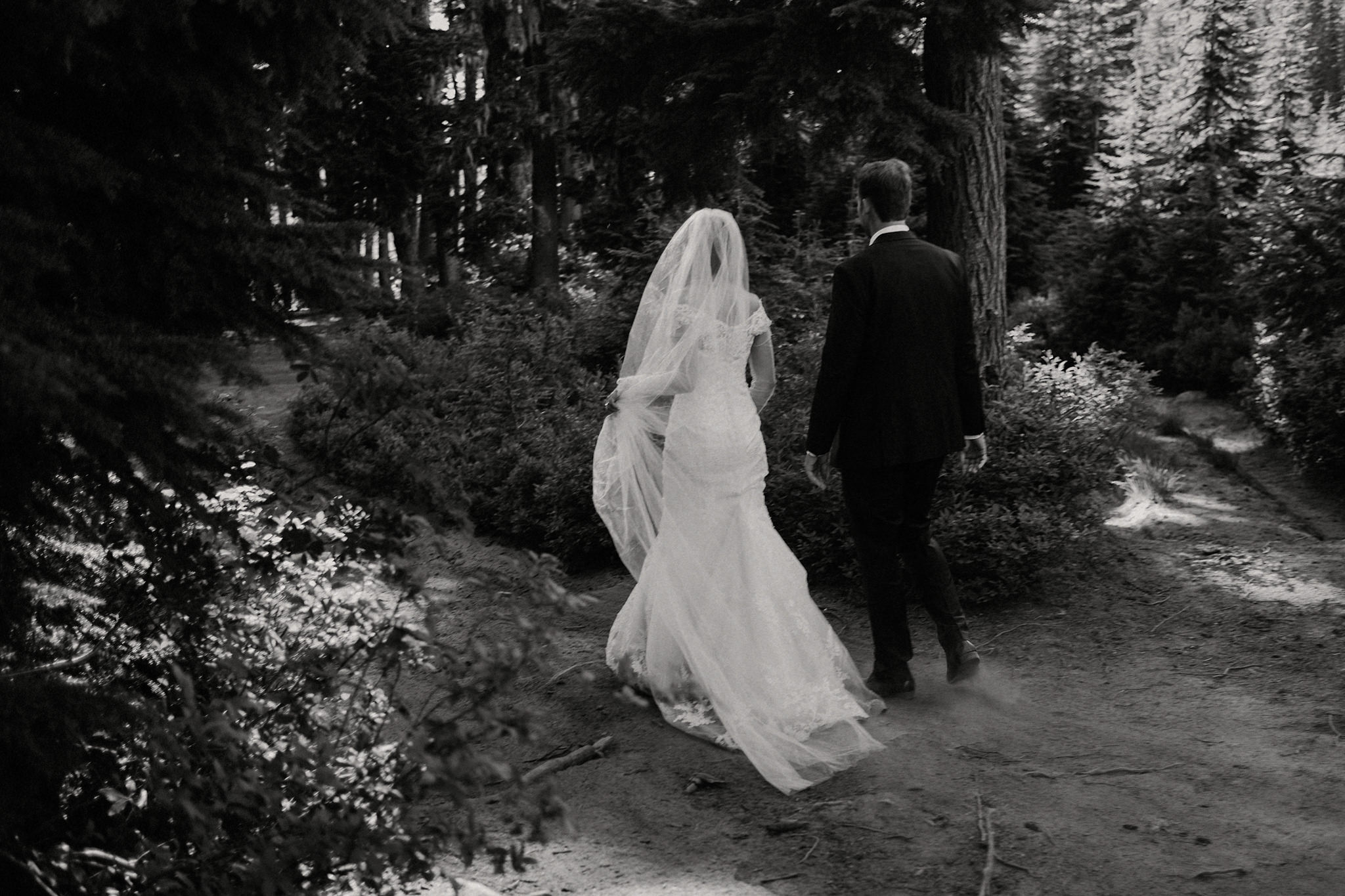 black and white cascade mountains bride and groom walking photo