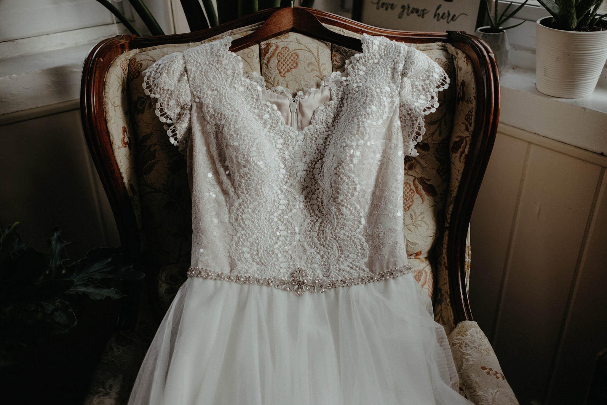cincinnati warehouse wedding bride wedding dress in chair