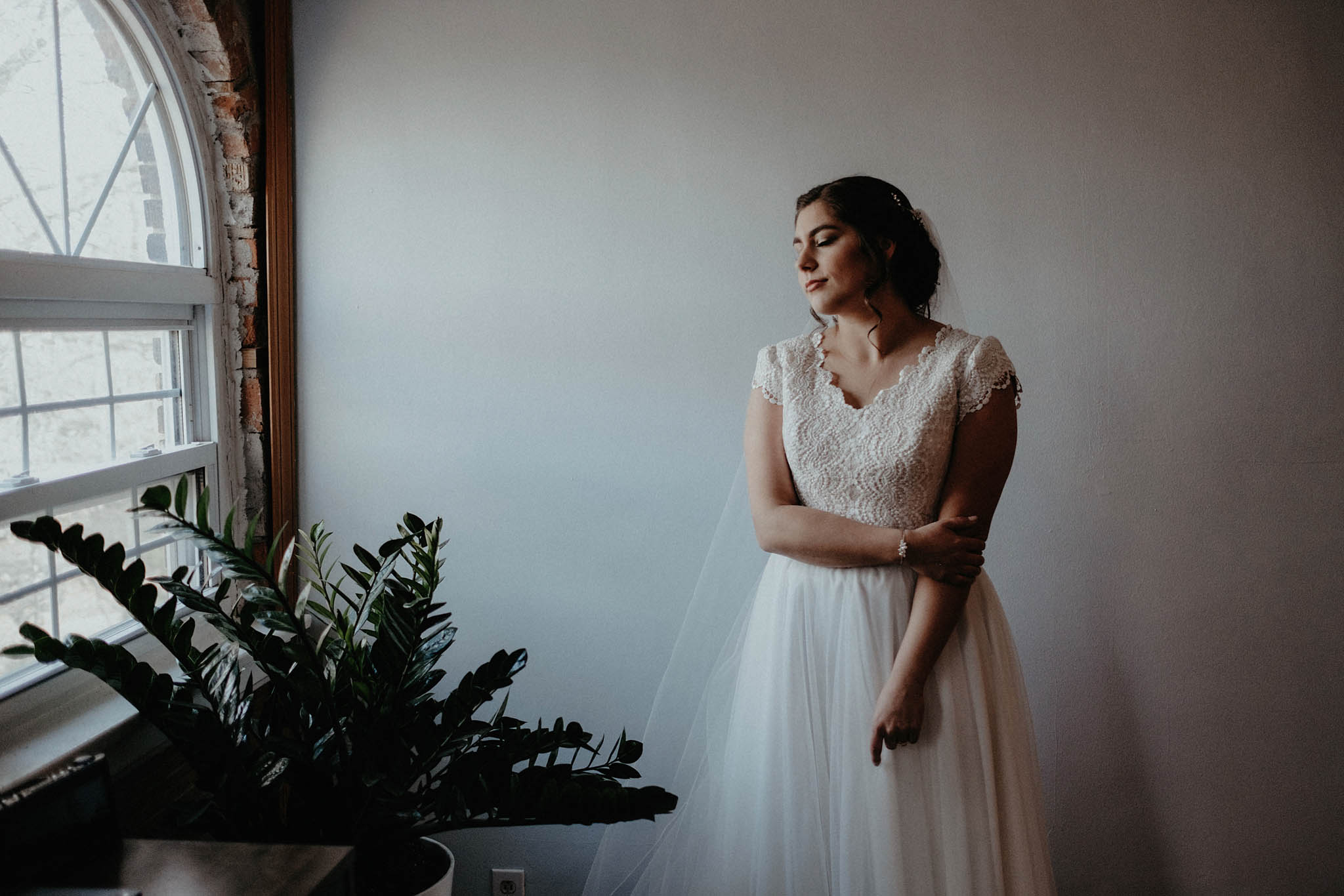 cincinnati warehouse wedding photographer bride window portrait