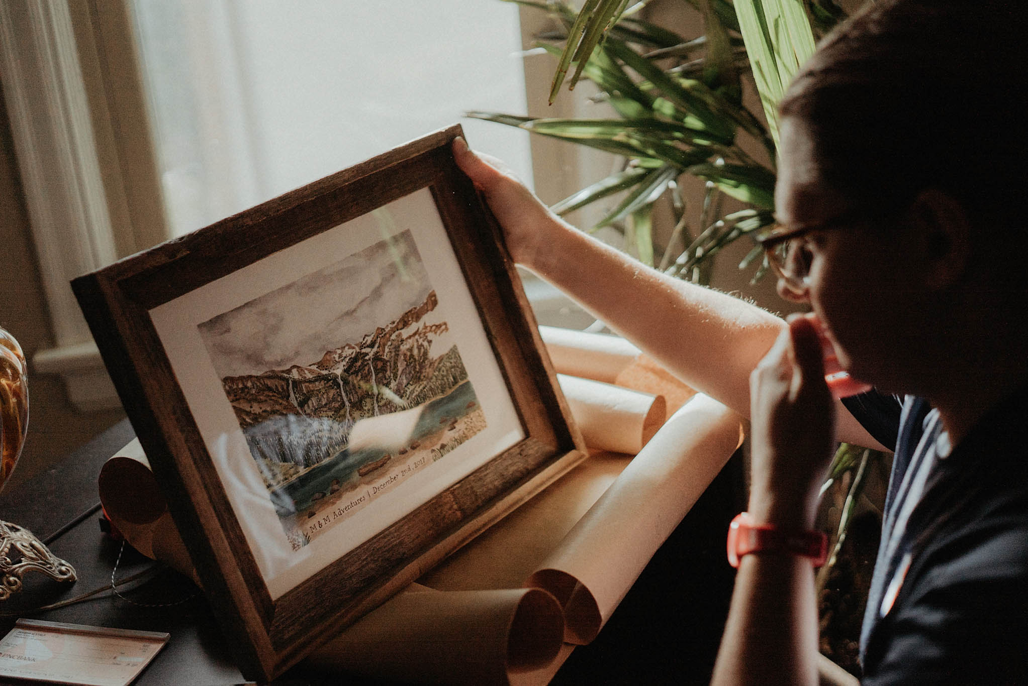 cincinnati warehouse wedding photographer groom looking at painting