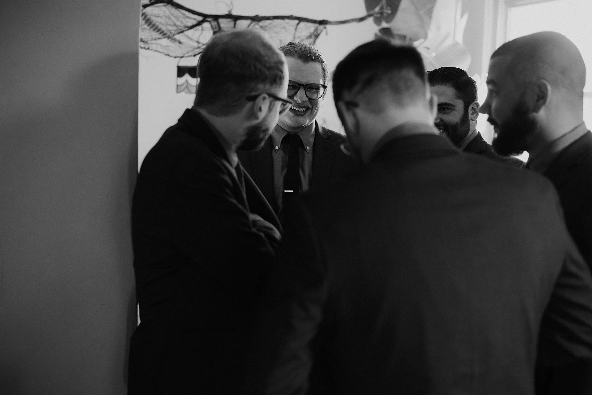 cincinnati warehouse wedding photographer groom groomsmen laughing