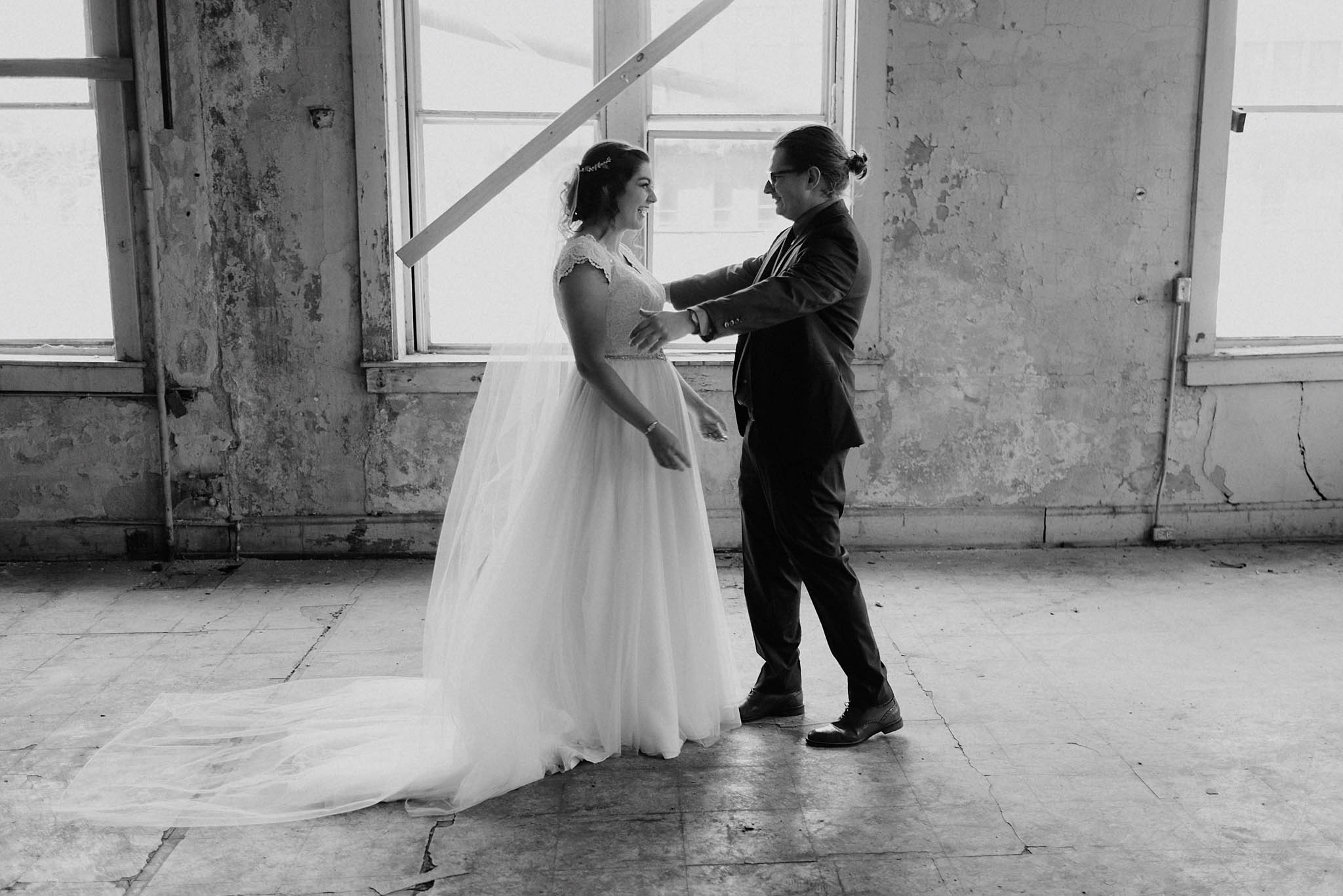 cincinnati warehouse wedding photographer bride and groom first look