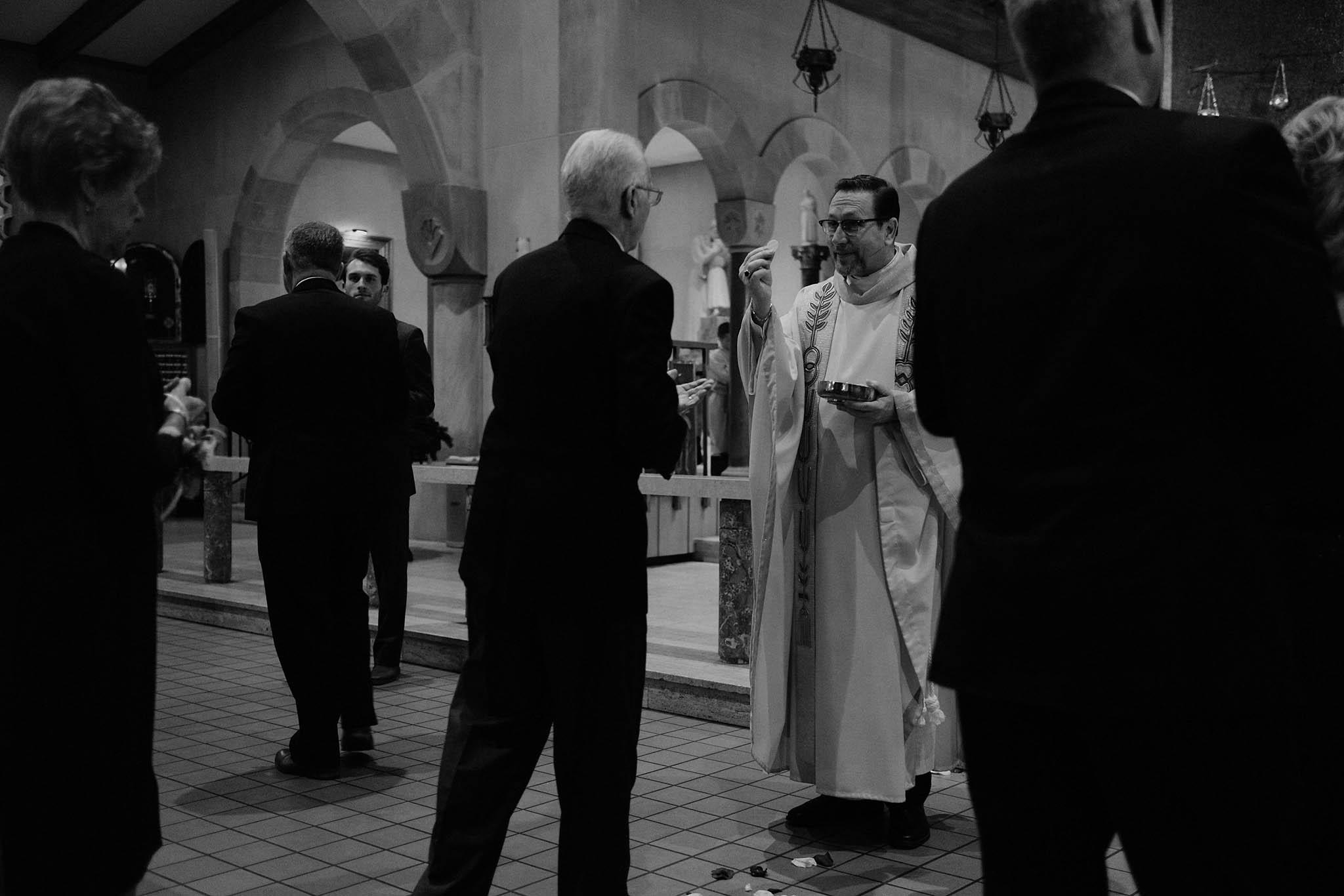 cincinnati warehouse wedding photographer cathedral church ceremony communion