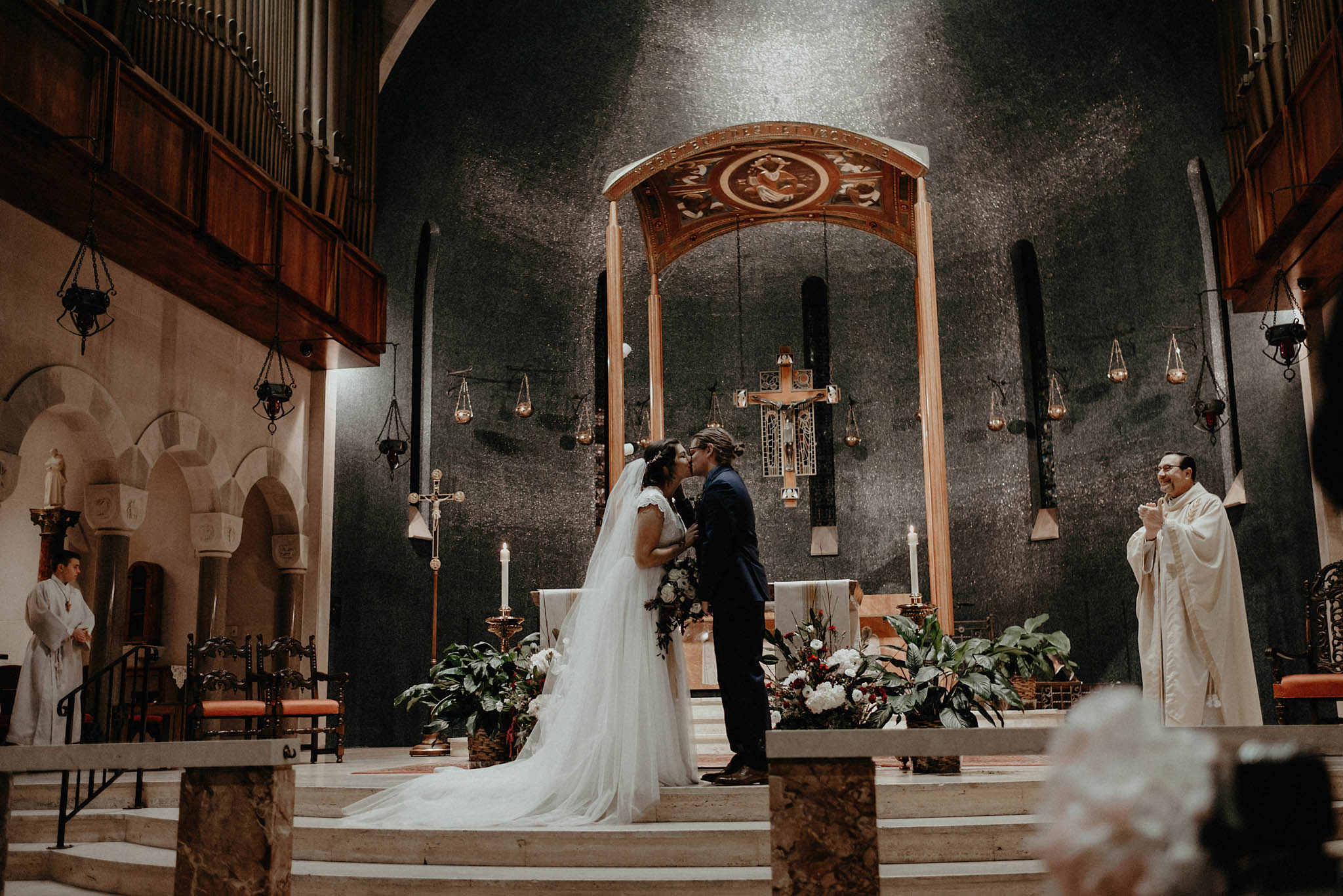 cincinnati warehouse wedding photographer cathedral church ceremony kissing bride and groom
