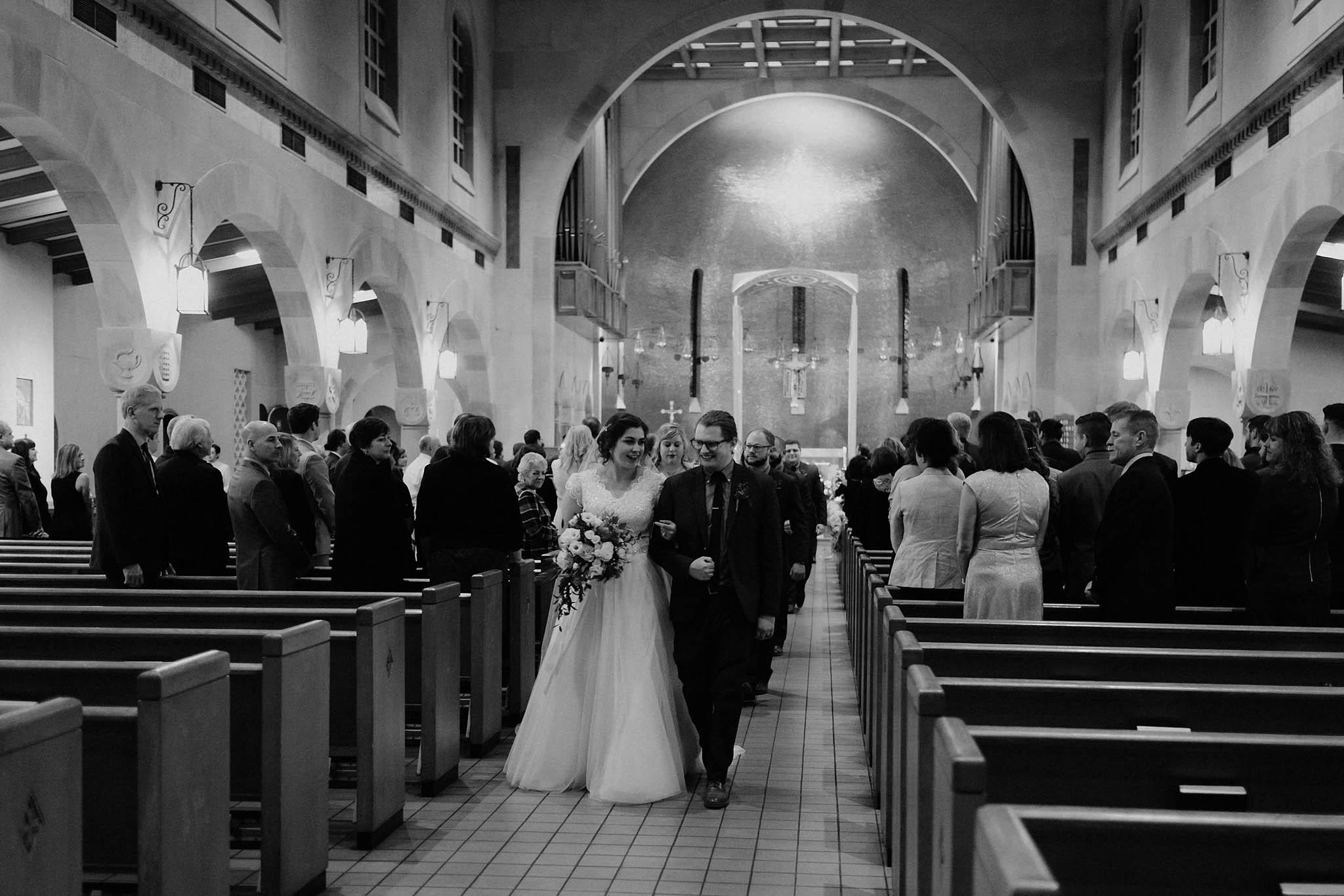 cincinnati warehouse wedding photographer cathedral church ceremony bride groom walking down aisle recession