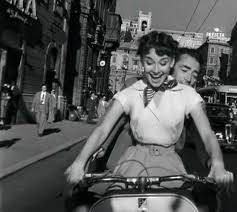 Hepburn riding a scooter for the first time in  Roman Holiday.