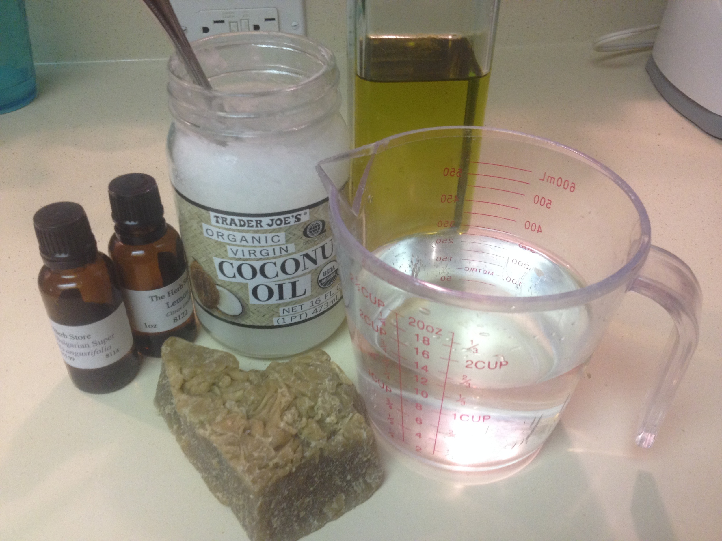 Ingredients from left to right: essential oils, coconut oil, olive oil, distilled water, and beeswax.