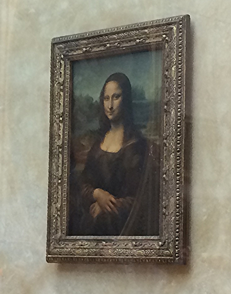 The Mona Lisa. It is encased in a glass security tomb that, in case of an emergency, will sink the priceless painting into a basement vault to keep it safe. Our tour guide told us that no insurance company is willing to insure this painting--it is too great a risk as it is literally priceless.