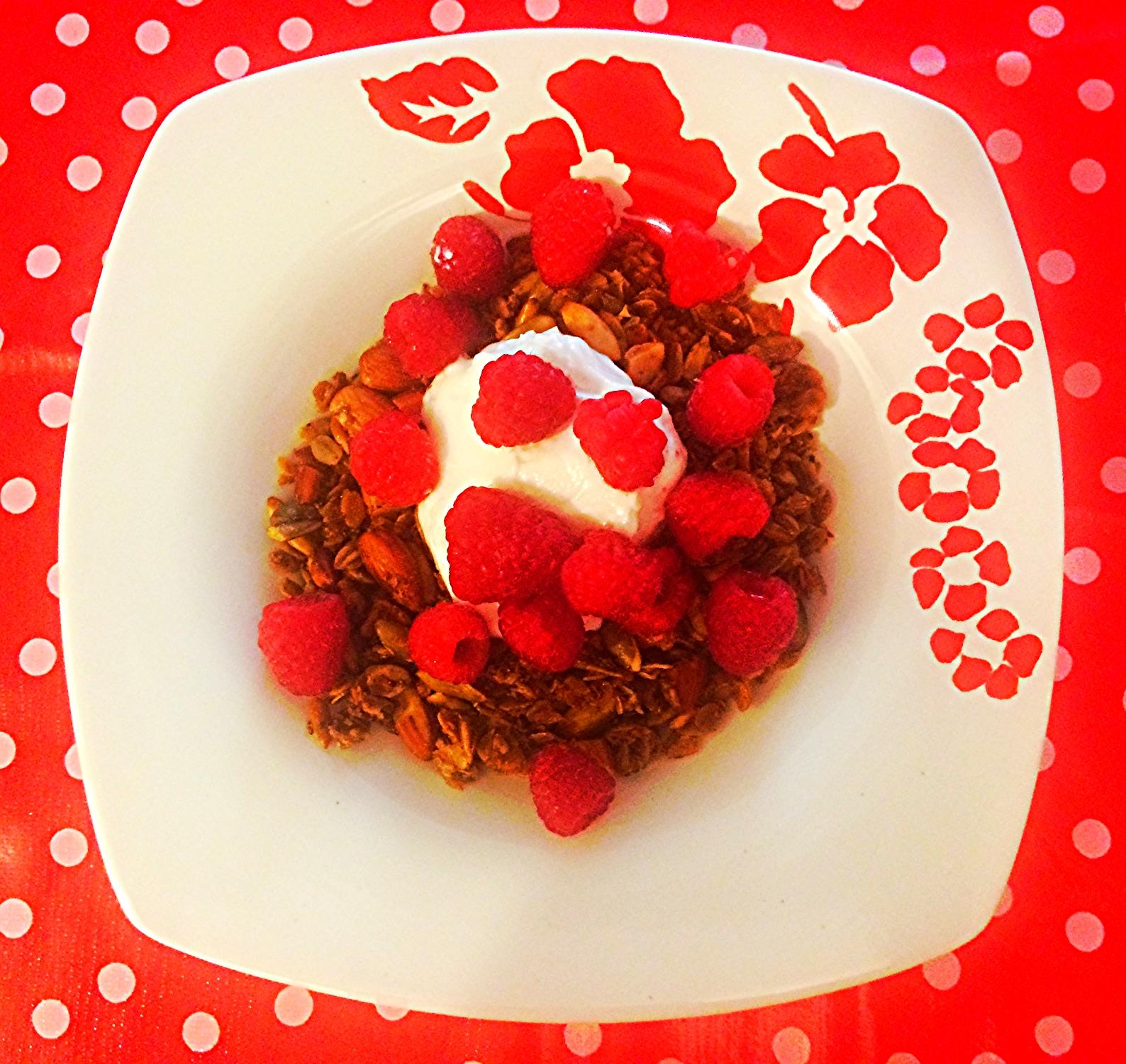 Mmmmm...looks like the perfect breakfast to me: granola topped with Greek yogurt and fresh raspberries.