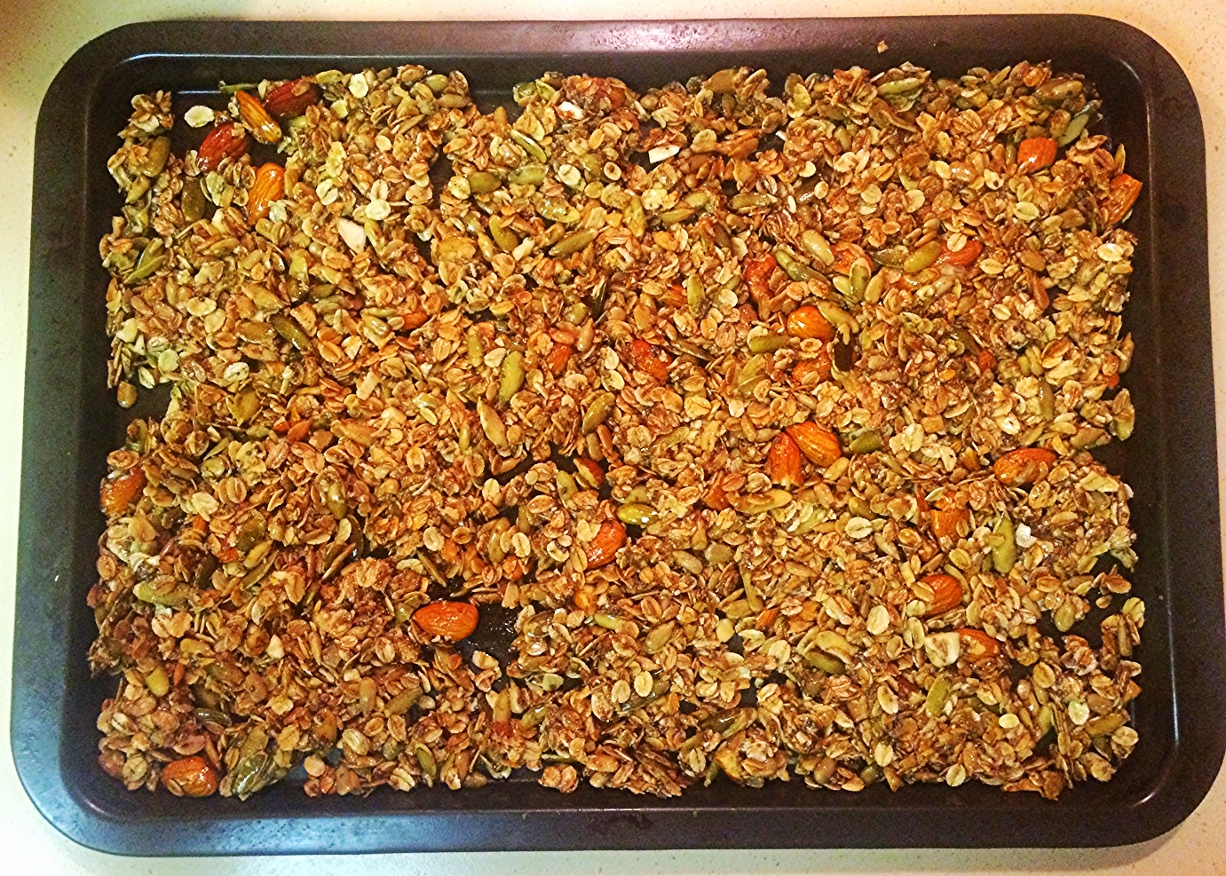 Raw granola mixture ready for the oven.