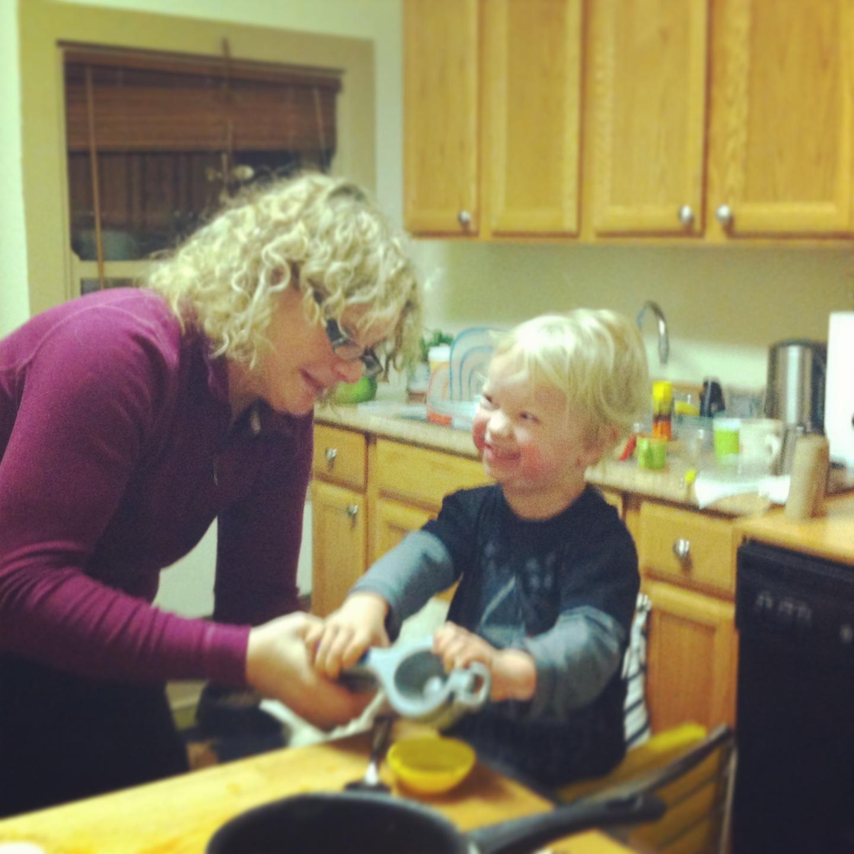 JoAnne is teaching Soren how to juice a lemon - takes  a lot of strength!