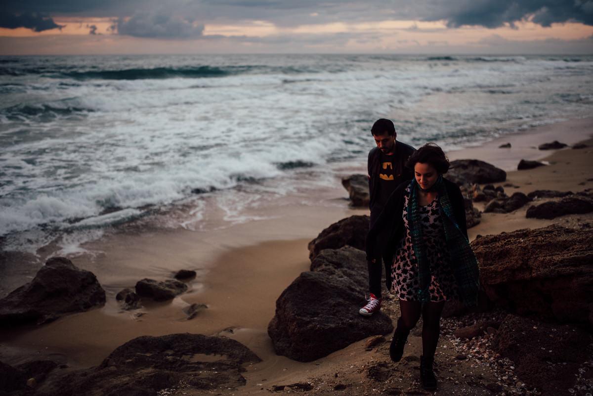 Artistic beach engagement shoot