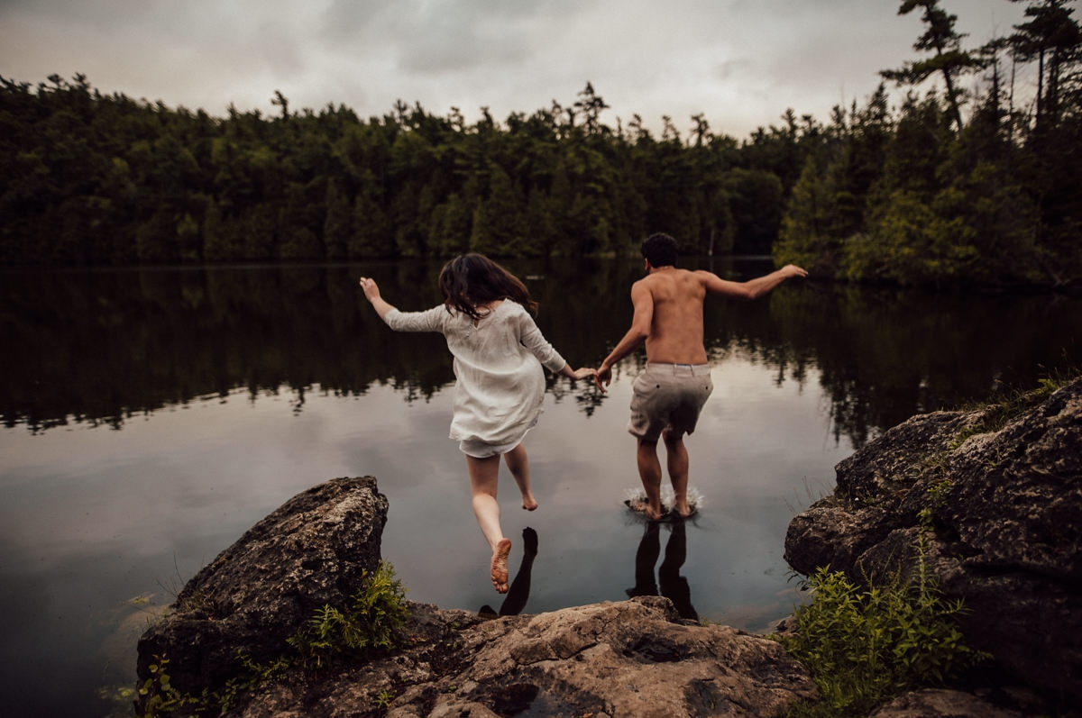 Couple jumping in water