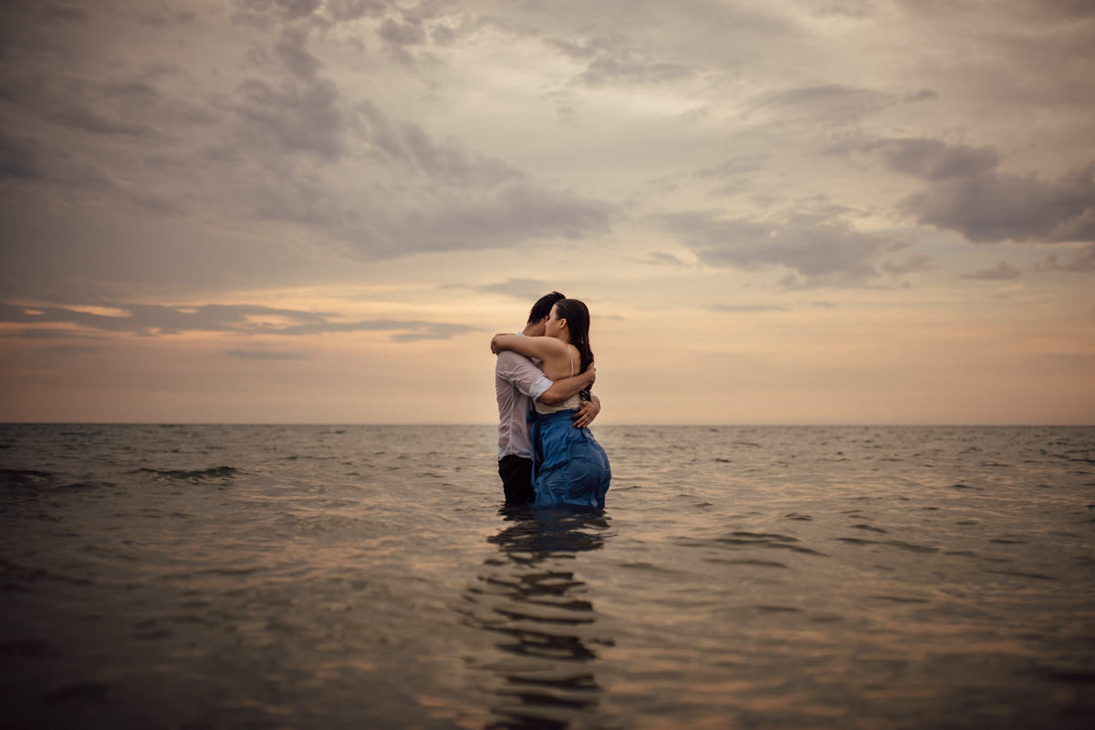 Couple in love hugging in water